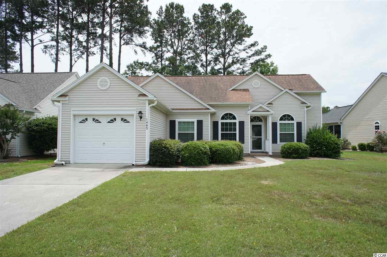 This beautiful home is located in the desirable Indigo Creek Golf Plantation, minutes from the beach, shopping and attractions, and a short golf cart ride or walk to the course. With soaring vaulted ceilings, an open floor plan, two bedroom suites and a private backyard with mature landscaping, this home has the perfect combination of features and location. The defining feature of the home is the vaulted ceiling, which extends over the kitchen, dining room, great room, master suite and guest suite. The Carolina room is open to the great room and is surrounded by windows that flood the home with light. The kitchen has ample counter and cabinetry space, a pantry and a large eat-in area, plus a separate laundry room with storage. Off the Carolina room is a concrete patio, overlooking the private backyard. Terrific location off of 17 Bypass, convenient to shopping, the Marsh Walk's entertainment and restaurants, the beach and numerous golf courses.