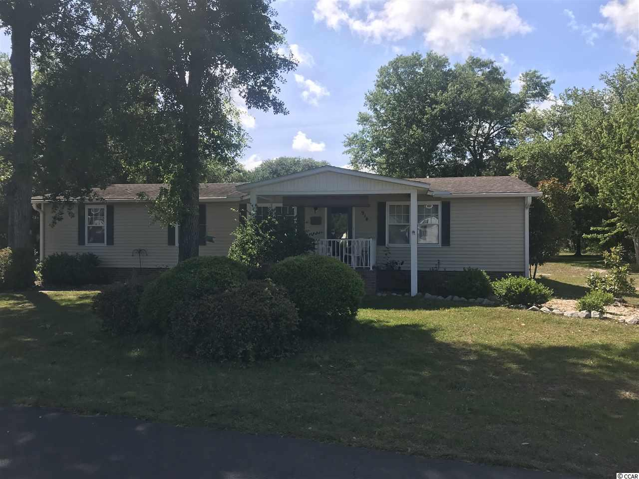 Charming home in quiet 55 and over Community of Live Oak. Home features large Carolina Room with 1 car garage. This neighborhood features a large pool with Club House.