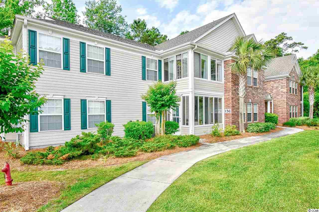 Welcome home to this 2 bed/2 bath end condo in Sterling Pointe. The main living area features top of the line laminate wood floors, a tray ceiling and ceiling fan. There is a separate dining area large enough for entertaining family and friends. The cook of the family will love the extra cabinets in the kitchen along with the new stainless steel appliances and plenty of room for storage in the pantry. Retreat to the master suite with a tray ceiling, ceiling fan, and 2 walk-in closets providing lots of storage. The master bath has double sinks and a large walk-in marble shower. There is an additional room off of the master that would make a great den or office or it could easily be converted back to a third bedroom. All 3 bedrooms have new carpeting. Step out to the enclosed porch/ sunroom and enjoy your morning coffee or evening cocktail. Building 136 is located at the back of the complex so this unit offers lots of privacy. Washer (new) and dryer are located in the unit for your convenience. Sterling Pointe is conveniently located near Waccamaw Hospital, Inlet Square Mall, shopping, dining, golf, and all the Grand Strand has to offer. Just minutes to the beautiful sandy beaches of the Atlantic Ocean. Whether you are looking for a permanent residence or a vacation get-away, you won't want to miss this one....schedule your showing today!