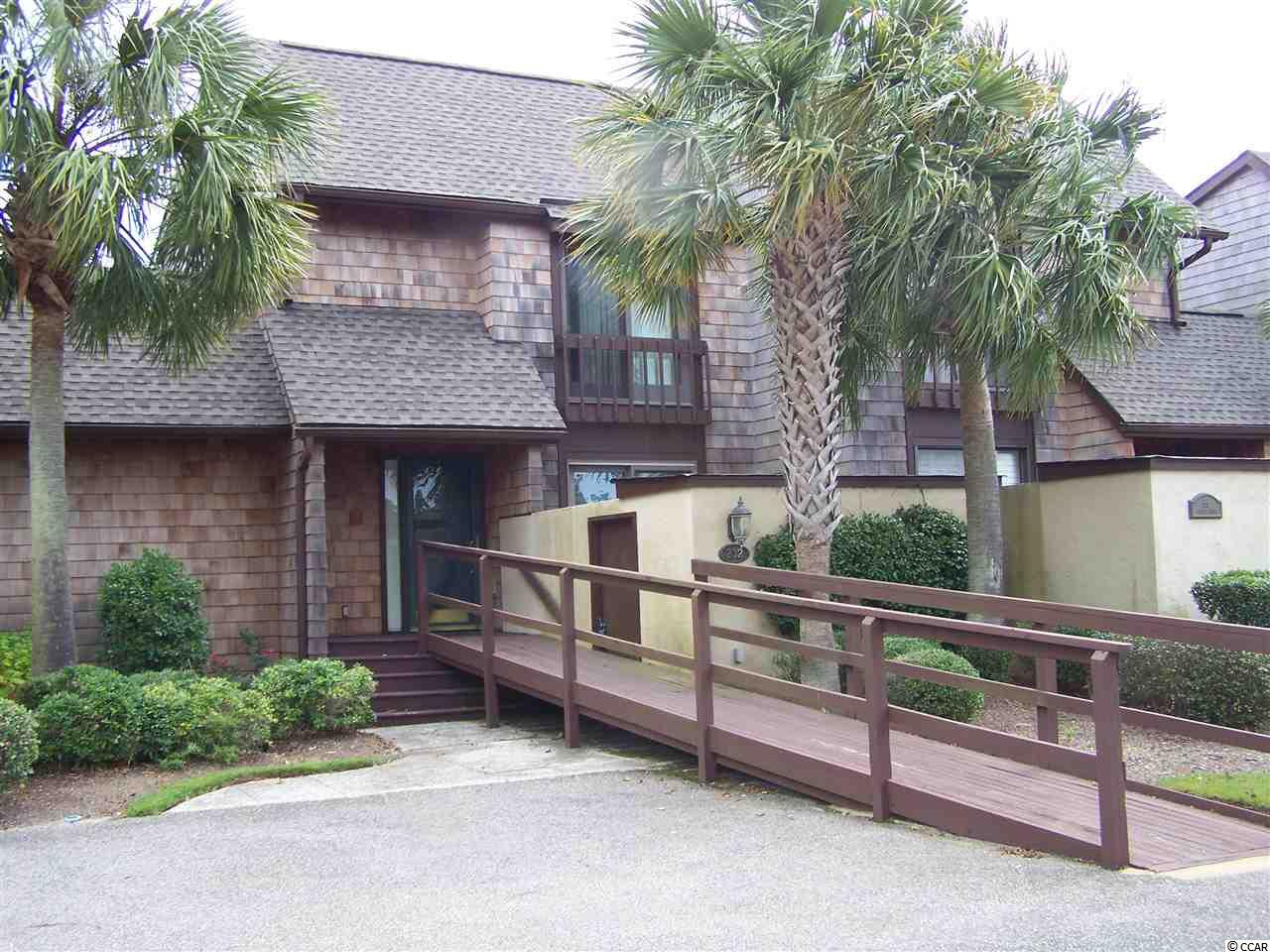 Beautiful 3 bedroom 2 bath condo in historic Belle Isle Yacht Club right on Winyah Bay with an unobstructed view of the Waccamaw River Bridge to Pawleys Island. In the evening watch the sun reflect off the historic Georgetown Light House or just sit on the deck and count the boats as they travel up and down the Intracoastal Waterway.   This unit has been updated with granite and a open floor plan with a downstairs bedroom suite with a walk-in shower. Additional upgrades include a new rood and Cedar siding.Sliding glass doors across the back of the unit give you a full view of the beautiful bay. Amenities include a private gated beach house on Pawleys Island, 2 pools, tennis and marina.