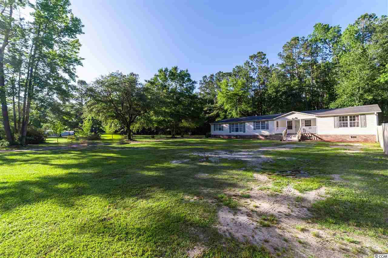 One word perfectly describes this Conway home in the Greenwood Estates community- SPACIOUS! Not only is this rare find a magnificent Triple-Wide Manufactured home that contains a little under 2,900 Heated Square Feet, but it also sits on a little Over 1 Acre of Land! Enjoy NO HOA DUES, a Large Yard WITH FENCE, Front and Back Porches, a Detached 12x24 Air Conditioned Garage, & 8x10 Shed For Extra Storage Space. This home features a Split Floor Plan with 4 Bedrooms, 3 Full Bathrooms, a Study off the Master Bedroom which could be used as a 5th Bedroom, Laundry Room, Large Open Kitchen, a Large Living Room & Bonus Room! The Master Bathroom features a Walk-In Shower, Garden Tub, Brand New Double Sinks. Each Bathroom also features New Sinks & Cabinets/Countertops as well as New Toilets. In addition to these improvements, Brand New Carpeting was recently installed throughout the most of home as well as Fresh Paint! Wood burning Fireplace in Family Room! Make this Spacious Country Home yours today & Call To Schedule A Showing Today! Easy to see!!
