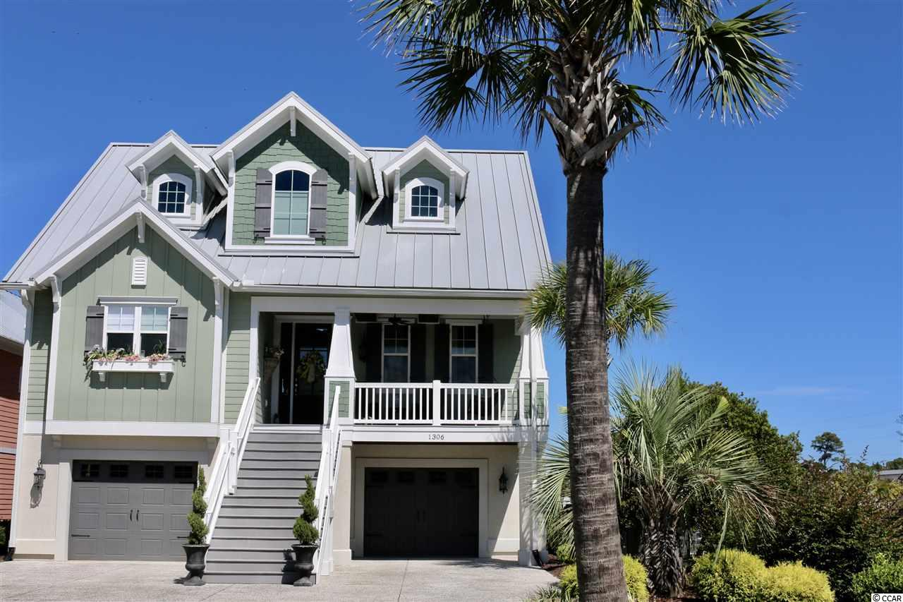 This Gorgeous Custom Low Country Home with views of the Intracoastal Waterway is a boaters dream!!!! Has a modern feel with clean lines and modern fixtures and rounded wall corners. This 4 Bedroom, 3 1/2 bath home has so many different options for sitting areas or game rooms.  Open floor-plan with Hardwood floors, large windows to capture the water and marina views. Gourmet kitchen with granite counters, custom cabinets, stainless appliances, pantry, and an island. Kitchen has lots of storage. The Living Room overlooks the water with an extended deck for outdoor entertaining. Great floor-plan with laundry room, 1/2 bath and master all on the main living floor. Large Master Suite with sitting area and deck overlooking the water... Home has Hardi-plank and metal roof, and crown moldings thru-out. Gorgeous Hard wood floors throughout main living areas... Carpet in Bedrooms and tile in baths. The in-law suite located on the ground floor has tile throughout and overlooks the pool and marina. It features a full bath, bedroom and family room area. Also  a large deck that extends the width of the home for outside entertaining..it also includes an outdoor bar and grilling area. Beautifully Landscaped with irrigation and the infinity pool is the perfect place to end a long day!