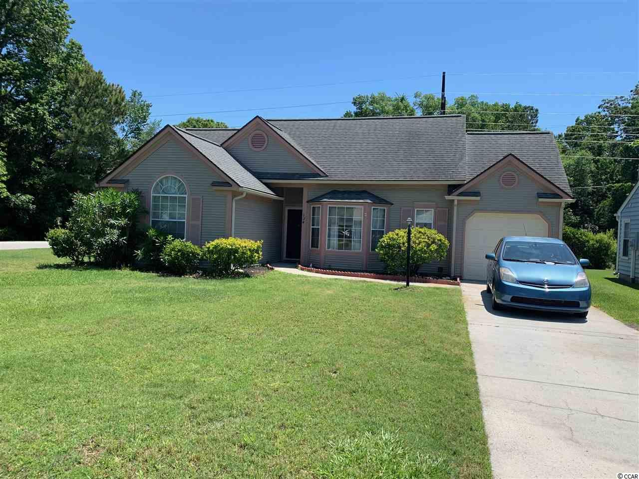 Wonderful 2 br, 2bath furnished home in 55+community. Close to Tennis courts, club house and Pool. Enjoy golf cart to the beach, shopping and restaurants. Enjoy large kitchen, Living room, Carolina room, Large bedrooms and a dinning room. The separate laundry room and garage gives extra storage. A perfect beach home!