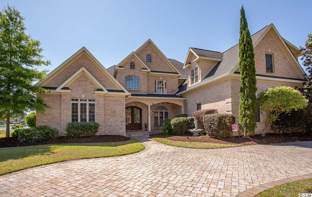 This magnificent custom built, all brick waterfront home offers over 100 feet of lake front that includes a boat slip and its own private sandy beach.  Located in Carolina Forest's most prestigious community of Plantation Lakes.  From the moment you enter the home you'll notice the warmth of the wood floors and attention to every detail.  From the two-story entrance foyer you can see the flood of natural light coming in from the lake.  Up front off the foyer is the study or office area currently used as the owners retreat.  Just past the stairs is a formal dinning room with direct access into the family room.  Like the foyer the family room offers two-story ceilings.  As you enter the kitchen just off the family room you will notice the top of the line appliances and beautiful granite counter tops.  From the breakfast nook and a secondary FR enjoy direct lake views.  The owners suite, laundry room round out the first floor.  Upstairs offers 5 bedrooms each with its own bath.  One of the bedrooms offers a nanny suite with direct access from the garage and a built in wet bar.  The unobstructed views of the lake, boat slip and private beach are second to none.  The quality of construction exceeds the expectations for this community.  Plantation Lakes offers a central amenity complex accessible by auto or by boat.  The community offers navigable boating waters for owners.  The location is close to every convenience necessary.  Please contact the Listing Agent for most current information.