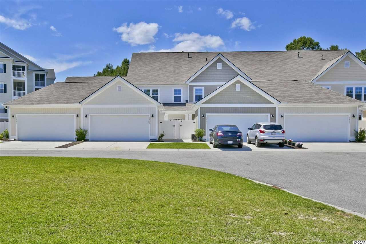 This is your chance to own an almost new, very large townhouse in the heart of Murrells Inlet.  Located in the renowned International Club golf community, this home features a two car garage, large courtyard area, first floor master, and all the modern updates.  The courtyard area between the garage and front door is the perfect area for grilling out or just relaxing and enjoying the weather.  The living area has hardwood floors and leads into a kitchen with granite countertops.  The master has a walk-in closet and walk-in shower.  When you go upstairs you will be stunned by the size of the loft area, which could act as a second living room, man cave, kids area, or more.  Two more bedrooms and a large full bathroom, along with a large storage area complete the second level.  The International Club is located in the highly desirable Tournament Blvd area, close to the Marshwalk, Huntington Beach State Park, Brookgreen Gardens, some of the Grand Strand's top golf courses, and much more.  This unit is only three years old, barely lived in, and has a top of the line Lennox HVAC unit.  Don't let this one get away!