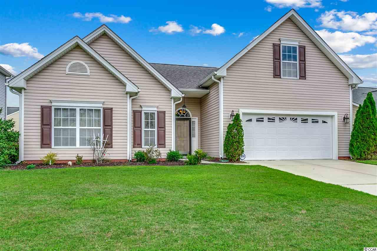 IMMACULATE 4bd/2ba w/ fireplace on the lake in desirable Burcale Commons - ALL BEDS ON 1ST FLR & only 10 mins to the beach! HUGE bonus space upstairs works great as a 4th bedroom, study, office, recreation room, media room, mother-in-law suite or guest suite. Lrg All Seasons room that overlooks the lake can easily be converted from screened porch to Carolina room. Use the extended brick patio for entertaining including family get-togethers and BBQs! Lrg community pool, club house, and playground great for families with kids! Burcale Commons is just a few minutes to everything Myrtle Beach has to offer including Coastal Grande Mall, Tanger Outlets, marinas, public docks, landings, restaurants, golf courses, shops, entertainment, Myrtle Beach International Airport, Broadway At The Beach, The Market Common, Barefoot Resort and Coastal Carolina Univeristy (CCU).