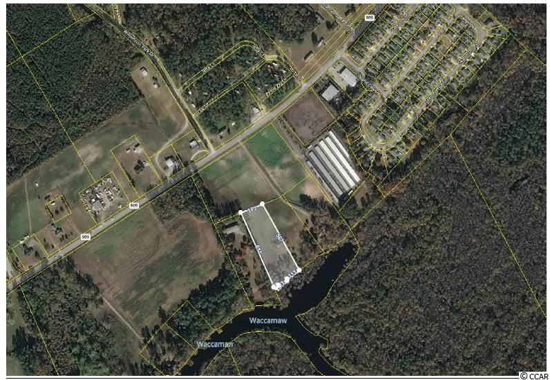 Looking for a piece of land directly on the Waccamaw River that did NOT FLOOD during Hurricane Matthew or Florence?  This is it!  Almost 3 acres of beautiful land to build on.  111' of water frontage along the river.   Convenient location right off of 905.  Adjacent 2.45 acre lot is also available for sale and listed separately.