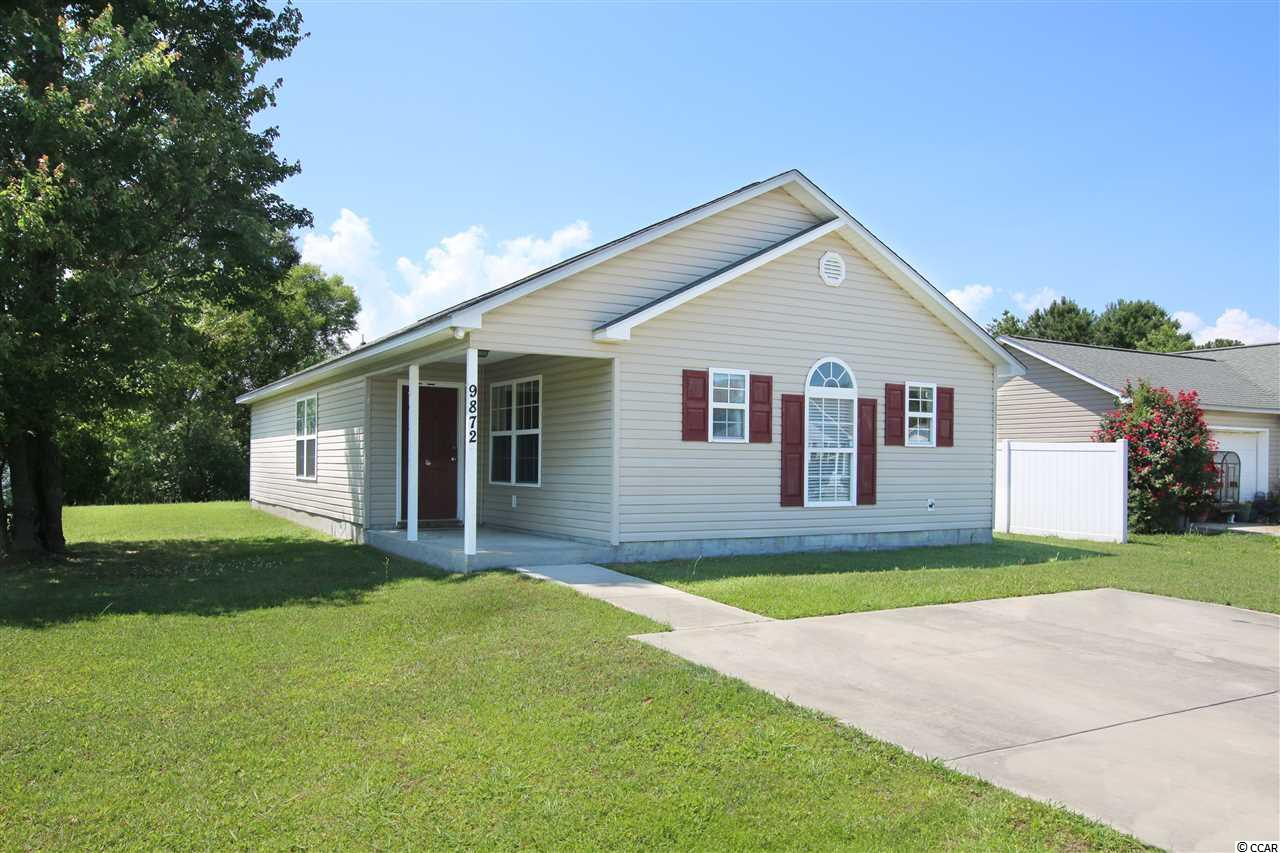 Introducing this adorable 3 bedroom 2 bath home located in the Pines of St. James community. This home has laminated wood flooring, fresh paint, vaulted ceilings, plant shelf, ceiling fans, abundance of natural lighting, white on whites appliances, smooth flat top range, built-in microwave, breakfast nook/dining area with elegant chair railing including shadow box paneling, and a sliding glass door which opens up to the relaxing side patio. This home provides you close proximity to the beach and golfing along with all the other attractions and amenities of Myrtle Beach and Murrells Inlet, with fine dining, wonderful world-class entertainment, fishing piers, the Marsh Walk, and exciting shopping experiences on the Grand Strand. Just a short drive to medical centers, doctors' offices, pharmacies, banks, post offices, and grocery stores. Check out our state of the art 4-D Virtual Tour.