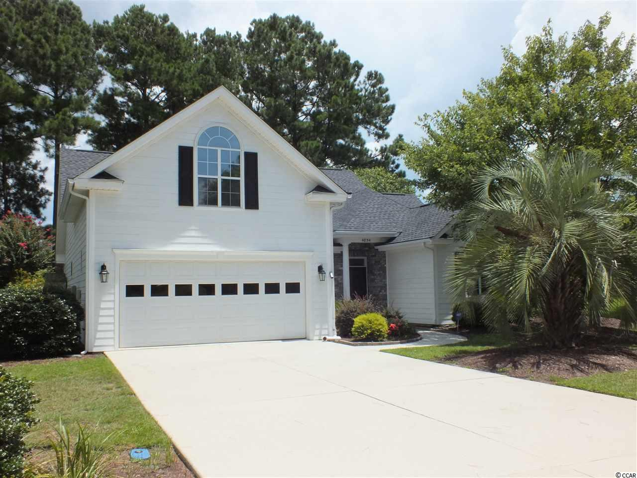 """This absolutely beautiful 4 BD, 2 BA home with great curb appeal, is located on a large lot in the much desired, GOLF community of Waterford Plantation. Included in this remarkable home is a formal dining room, Carolina Room and Bonus Room with plenty of storage. Kitchen comes equipped with 42"""" cabinets with crown moldings, Granite counters. Master bedroom on the first floor includes a large walk-in closet and the bath has a shower, whirlpool tub,  sink and a vanity. Two other bedrooms are located on the first floor. A large Carolina Room with French doors is in the back of the house overlooking a patio, pond, and fenced in backyard.  The Bonus Room on the 2nd floor is setup for the """"The Man Cave"""" or """"Craft Room"""", or forth Bedroom with plenty of storage. Ceiling fans are located in each bedroom and also the Carolina Room, Living room, and Bonus Room. Gorgeous hardwood floors enhance the living room, dining room. study and kitchen. Tiled floors are in the laundry room, bathrooms and Carolina Room. Plantation Shutters in the Carolina Room enhance the look. Each bedroom is carpeted.  Home has been meticulously maintained and ready to move in. Many amenities await you in this very friendly, active community which includes a Jr. Olympic sized swimming pool, cabana, fitness center, tennis courts, basketball, volleyball, playground, sidewalks and walking trails. The community with low HOA's is located in top-rated Carolina Forest school district and close to shopping, beach, theaters, hospital, post office, restaurants and all of the great things that Myrtle Beach has to offer. Measurements are approximate and must be verified by the buyer. This is definitely a must see home. Don't miss out on this one!"""