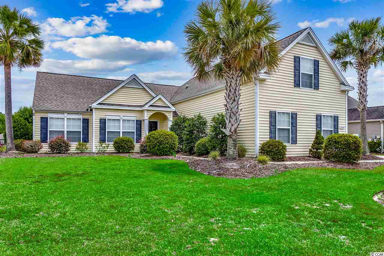 As you enter this wonderful open floor plan, your eyes are drawn to the wall of windows and the magnificent lake view at the rear of the home. Continuing through the living room on the beautiful bamboo floors out the back door you are greeted by a spacious rear porch. Looking around you'll see numerous mature Palm trees from your large adjoining patio which is the perfect spot to grill on a Carolina night. Those trees and the lawn are the beneficiaries of the irrigation on site with it's own meter. Moving back inside you'll find a preferred split floor plan with an additional bedroom upstairs. New toilets as well as an 18 month new HVAC system are the finishing touches on this move in ready home complete with furnishings just waiting for you to come and have a look!