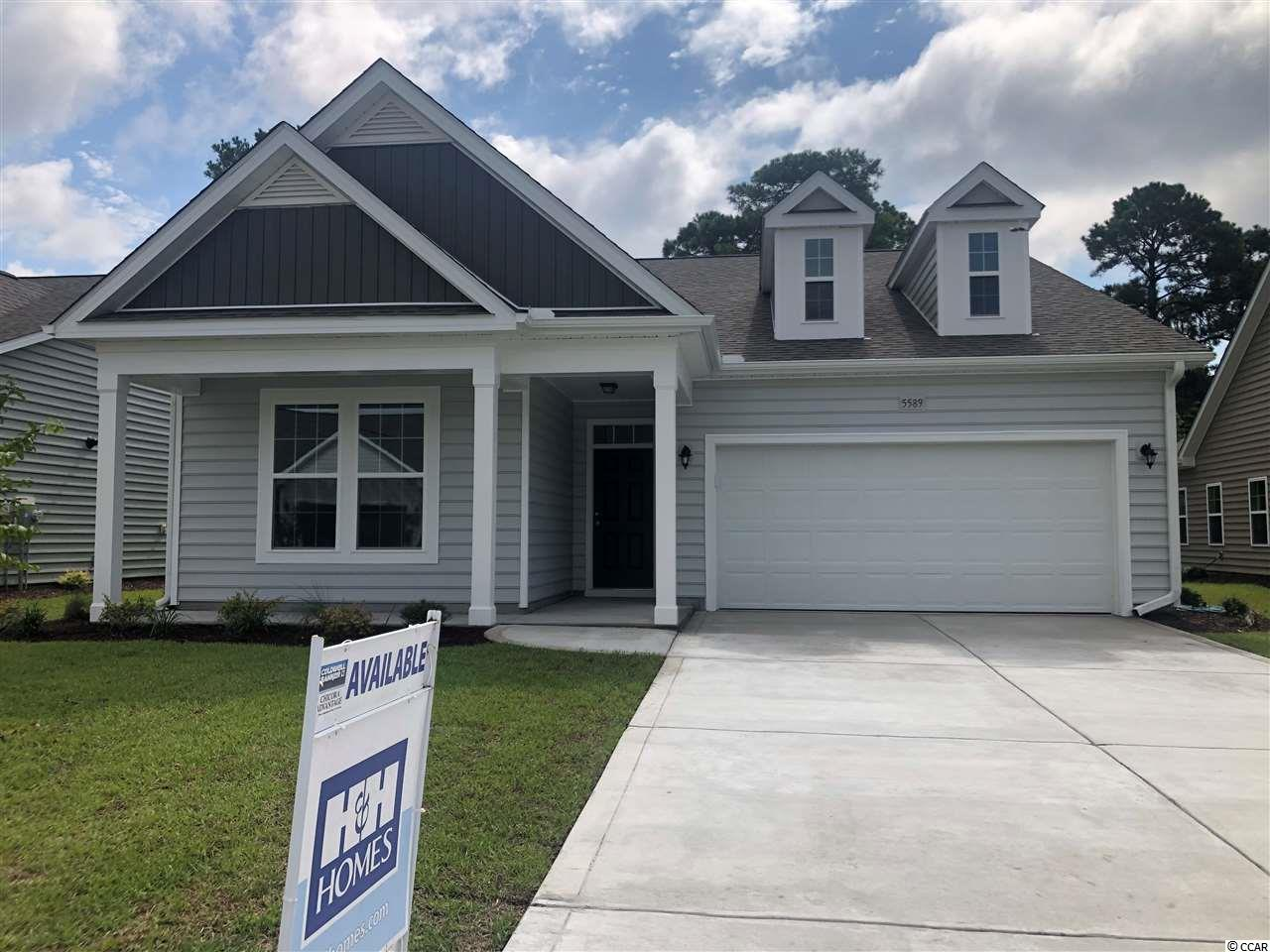**HUGE PRICE REDUCTION** PLUS CRAZY 8 INCENTIVE FOR LIMITED NUMBER OF INVENTORY CONTRACTS ACT FAST!  ASK AGENT FOR DETAILS! This brand new Belair Inventory Home will be finished SOON.  It is beautifully laid out as a 3bed 2bath.  Low Country style home with large covered front porch.  This home backs to protected preserves for extra privacy also placed in the back cul-de-sac of the community.  Come in through the large open foyer and with bedroom, guest bathroom & bedroom.  Walk further into your open Mudroom area which is located right off the Garage entry and spacious enclosed Laundry Room.  The open Kitchen has large Island Bar with overhang for seating with an enormous Walk-in Pantry.  Off the kitchen is the Casual Dining Room. Large Master Bedroom sits at the back of the home with Private on-suite bath that offers Huge Walk-in Closet & large walk-in shower with glass door enclosure.  All of this plus a nice size Rear Covered Porch offering privacy directly in the middle of home.  This home literally has it all!!  Kitchen will boast Ivory Painted Cabinets with crown molding, Recessed Can Lighting & gorgeous granite countertops.  Wood look Laminate flooring in all common areas, carpeting in bedrooms and Vinyl in wet areas including both bathrooms and laundry room.  The 2-car garage will have drywall and paint as well as garage door opener installed.  As a Brookberry resident you have full access to The Farms 2 resort-style pools, clubhouse, fitness center, basketball court, and a playground. All this plus access to the Atlantica beach club.