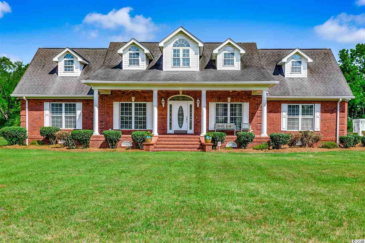 Beautiful all brick home on 1.9 acres.  With 3 bedrooms and 3 bathrooms this gorgeous home offers an open floor plan with formal Dining Room, expansive kitchen with breakfast bar, breakfast nook, trash compactor, and solid surface counters; an elegant formal dining room; the living room is open to the heart of the home and features built in's and a fireplace.  Off the living room through French doors you will find the Carolina room which opens to a covered patio to enjoy your morning coffee.   The master is located on the first floor and offers tray ceiling, walk in closet and gorgeous master bath.  Upstairs is the huge bonus room, which could be used as a fourth bedroom, media room, etc.  Tile, hardwoods, and chair railing throughout, with lovely grounds to park your boat, rv and other toys. Conveniently located to all the grand strand has to offer and no HOA dues!
