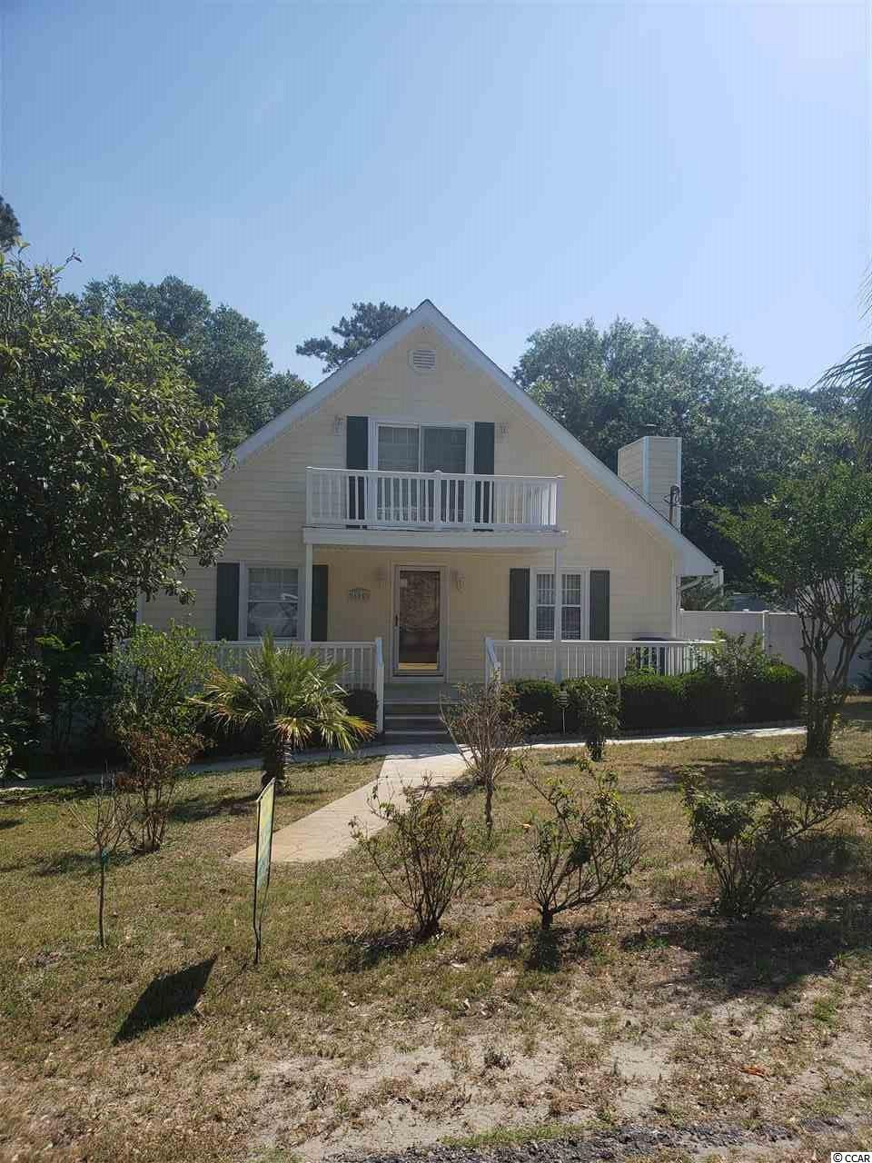 3BR / 3BA with full basement on large lot walking distance to the beach! Home features open living room, kitchen, dining, master suite and extra full bath on main floor. Two bedrooms upstairs share a bath. Huge 3 car garage / storage on bottom level. Nice covered porch on front and 750 SF deck off rear.