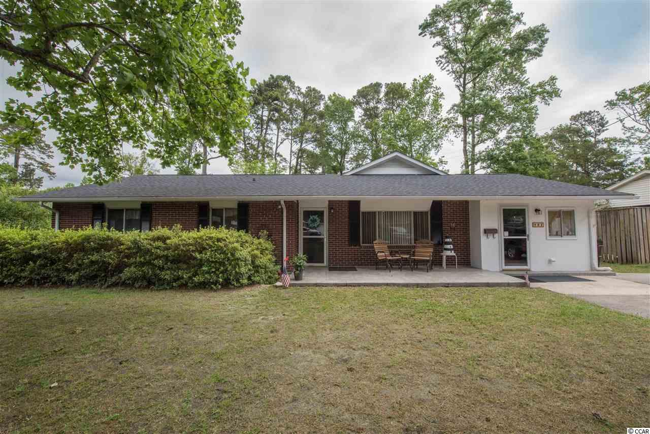 """REDUCED, SELLER SAYS SELL!!!! OWNER FINANCING AVAILABLE..There's LOCATION, and then there's LOCATION!!! Situated in the """"Old Pine Lakes,"""" golf course section of Myrtle Beach, this centrally located home has tons to offer. Featuring 5 bedrooms and 3 full bathrooms, this large home for the area is waiting on you. Entering through the large formal living area, recently installed floors take you into the kitchen and large, bonus media area and outside to the oversize screen porch. Situated on a rare dead end street, you will find peace and quiet on this over quarter acre lot. With mature foliage you will not find in a new homes community, experience the old school charm of southern beach living. With over 2,500 sq ft. to work with, and a added attached bonus space upstairs, you can make this your forever home! Close to restaurants, shops, hospitals, schools an of course, just three blocks to the blue Atlantic! Call today for your private showing."""