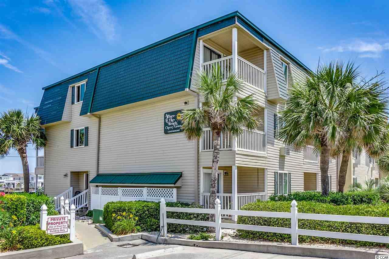 Don't miss this very well maintained condo overlooking the Cherry Grove marsh and just across the street from the beach.   This unit features new flooring, new paint and updated furnishings.  Owners have installed a second full bathroom that most units in the building do not have.   The balcony overlooks the Cherry Grove Marsh.  A Place At The Beach has just undergone major exterior renovations including new siding, new roof, and new decking.  All expenses associated with updating have been paid by seller.  The location is walking distance to the Cherry Grove Pier, the marsh, fishing, and only 1 mile from Boulineaus, restaurants, etc... This is a turn key condo that would make a perfect beach getaway, second home or rental investment. Check it out today!