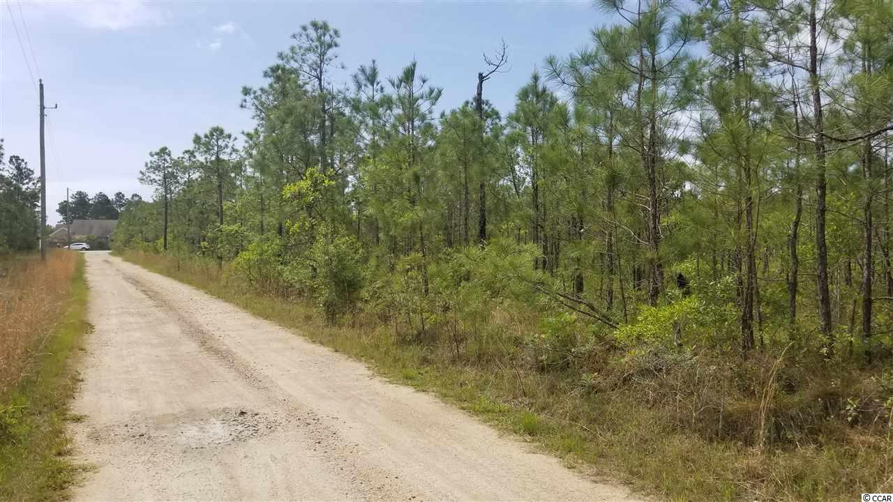 10 acres across the street from Barefoot Resort, on Water Tower Rd., near the hwy 22 and hwy 31 intersection.  The property was previously zoned commercial but was changed to Farm at the seller's request.  The adjacent 12.25 acres is also listed.