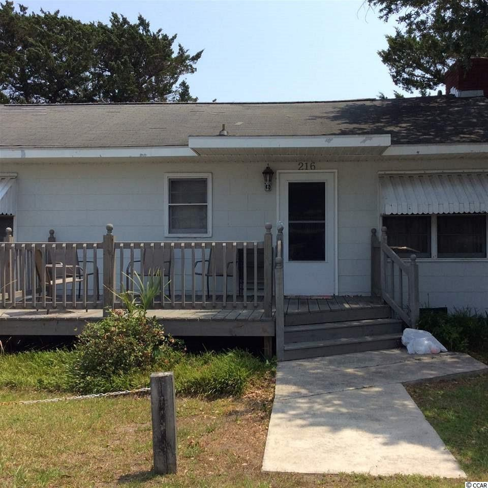 This little summer beach home sits on a perfect lot just 1 block off the Ocean. The value of this property is in the land. Build your dream house in a perfect location close to all the charm that Cherry Grove Beach has to offer.
