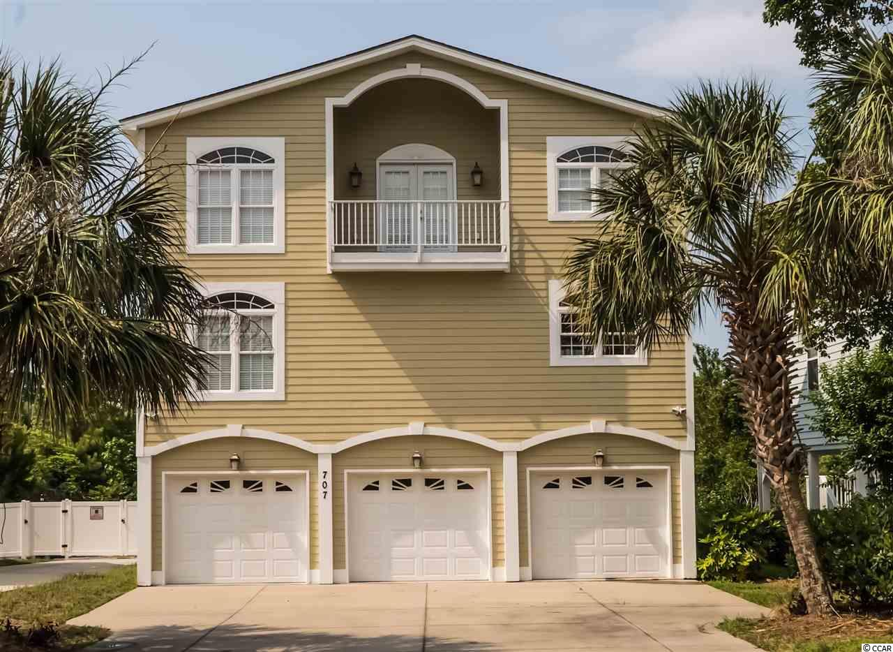 Custom built raised beach house located in the heart of the Ocean Drive section of North Myrtle Beach in a quiet neighborhood that's just a golf cart ride to the Atlantic Ocean.  Barely used as a second home and never rented this amazing house offers tons of storage, an elevator, an all seasons porch, a custom kitchen, and three bedrooms.  The 1st floor welcomes you with an open living room, large dining/kitchen, all seasons porch and a large bedroom with en suite bathroom.  Hop on the elevator and take the stairs to the 2nd story and relax in the spacious master suite with private balcony and a huge bathroom with garden tub, walk in shower, and private water closet.  The third bedroom with private en suite bathroom is just down the hall.  The home backs up to an expansive private wooded area for quiet evenings on the porch.