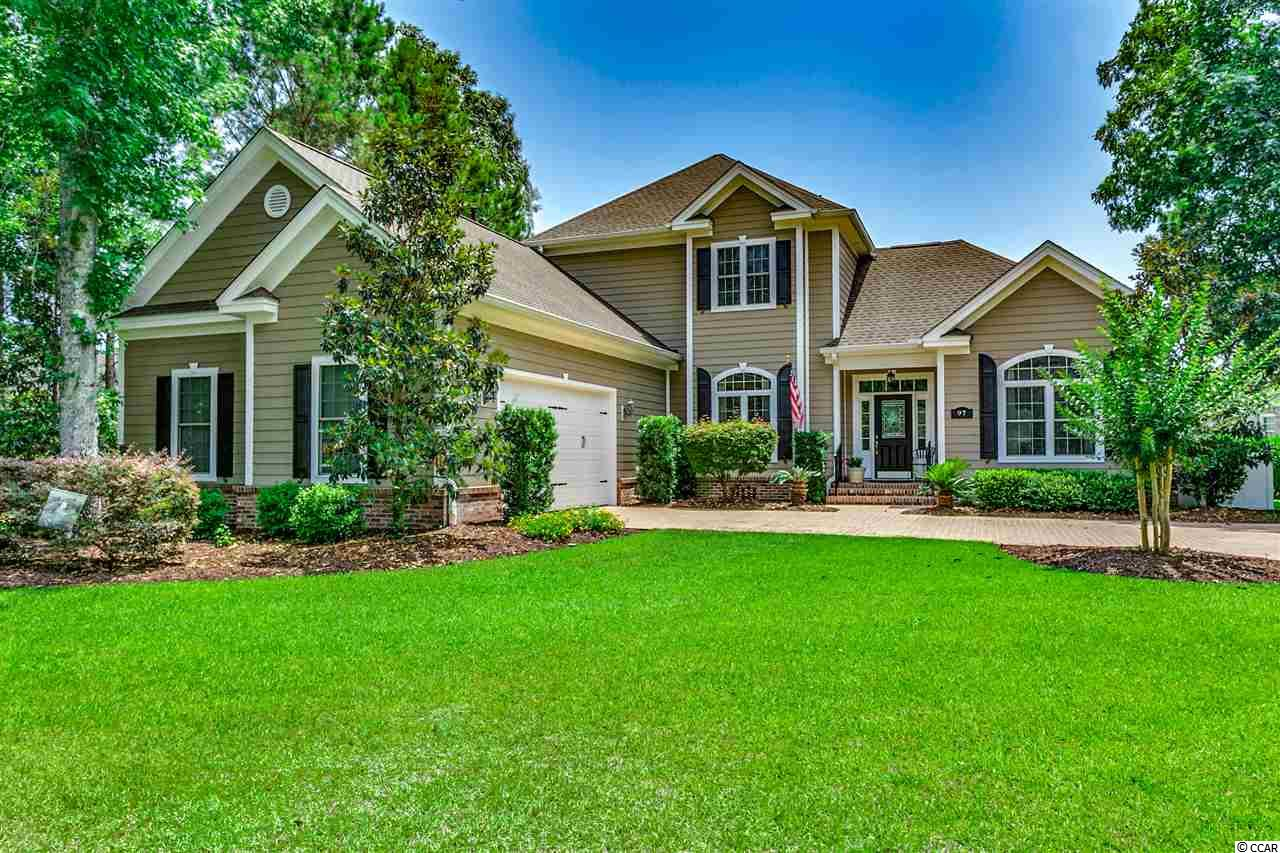 """Come, relax and enjoy the spectacular lake views this home has to offer from both levels.  97 Highwood Circle is located on a large 1/2 acre home site in the gated upscale community of Highwood at Prince Creek at the TPC of Myrtle Beach golf course. As you enter the foyer you will see this home is in immaculate condition! The living area has beautiful hardwood floors and a double sided fireplace for those cool mornings. Off the living area is a beautiful sunroom with 18"""" tile floors where you can relax and enjoy the lake view or venture out onto the trex deck.  The deck area is complete with awesome views and natural gas hook-up for your grill. The elegant master bedroom has a double trey ceiling, large en-suite bath, double vanity with granite tops and tiled walk-in shower.  The kitchen has 18"""" tiled floors, stainless appliances, natural gas range, granite counter tops, cherry cabinets and a large island.  Each of the guest bedrooms come with amazing views and each has it's own bath complete with granite vanity tops.  Three brand new A/C units, over sized garage with workbench, irrigation (well) system, large laundry room, cedar closet and brick paver driveway are all added bonuses!  Located only a few miles from the Waccamaw hospital, the Murrells Inlet Marshwalk, restaurants, shopping and numerous golf courses.  Schedule your appointment today!  When you visit this home, it will feel......like home."""