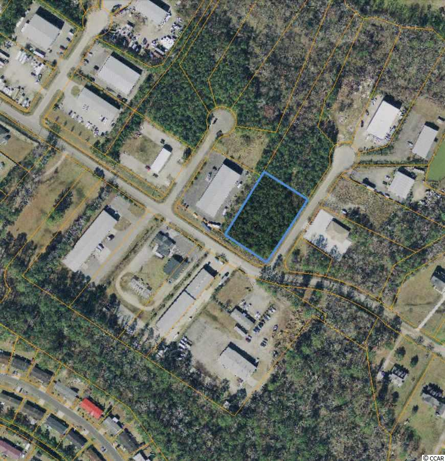 Conveniently located right off of Highway 707 (less than half a mile from Highway 31 extension), this 1+ acre corner commercial lot is in a growing industrial business park. Ideal for a warehouse, office, or workshop space.