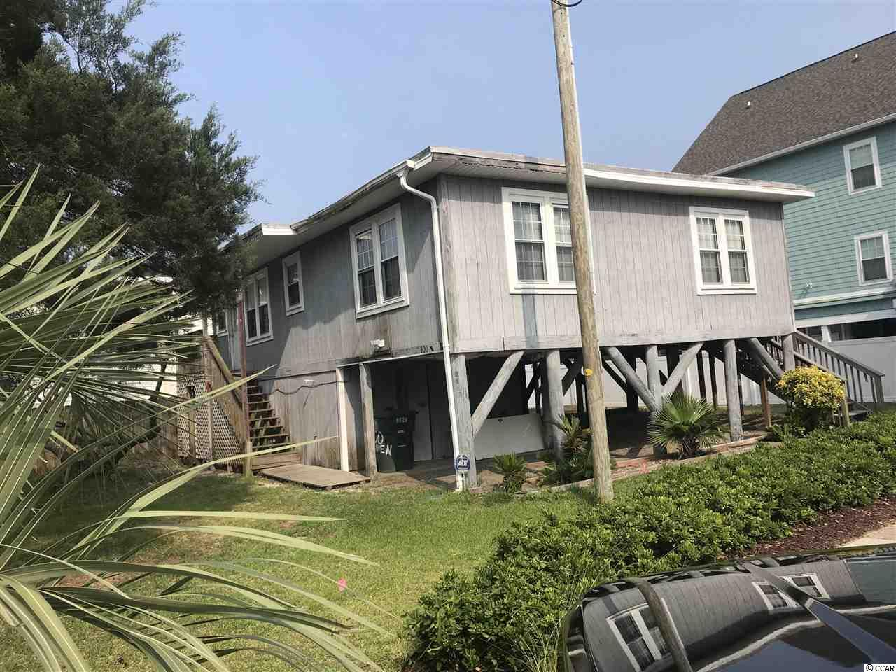 Affordable Beach Retreat in the family friendly Cherry Grove Beach! This raised beach home is a fixer uppers dream! Home features include 3 bedrooms, 1 full bath, solid real pine paneling, central heat and air, big front deck and only 1 1/2 blocks to the sparkling ocean! This is just the home you have been looking for at a price you may never find again! Don't wait, because this will not be on the market long! Home is sold as is and where is.