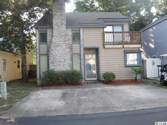 """Enjoy the small small community setting just blocks from the beach. This two story has a master bedroom down stairs and two large rooms upstairs. This is a comfortable home with a fireplace and a wonderful living area. There is a fenced in yard for privacy and where you can let out your walking partner to run around safely. This is a great house is a great community excellent for walking and enjoying the beautiful area with a pool and recreational club house. """"Sold As Is""""."""