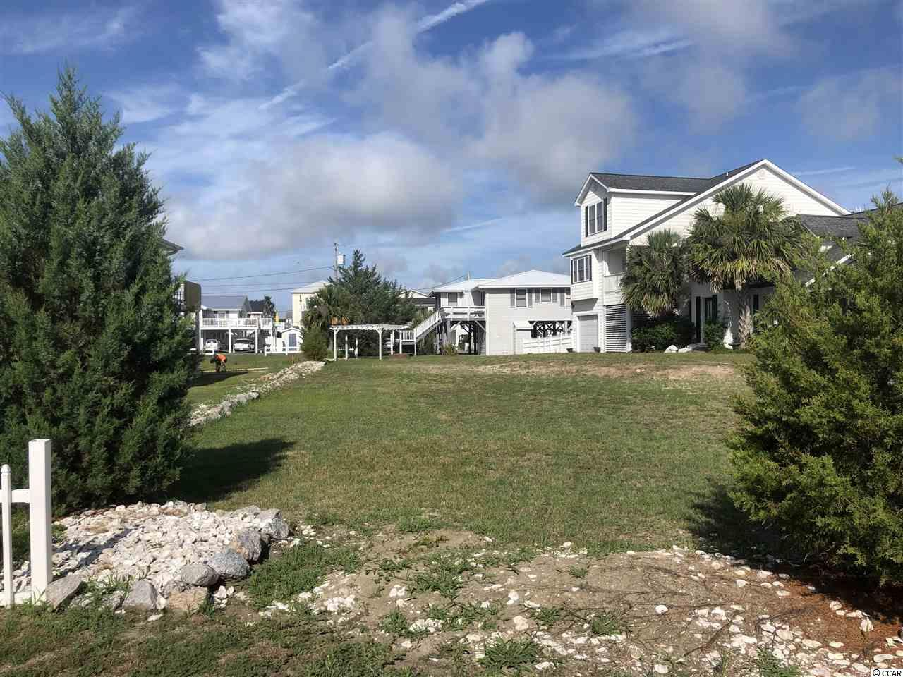 Beach style lot located just a few blocks off the ocean in the heart of Cherry Grove. Be sure to check out this homesite....located just a block from the marsh, 2.5 blocks from the oceanfront, 3 blocks from the Cherry Grove Pier and just a short distance to Boulineaus, shopping, restaurants and much more.