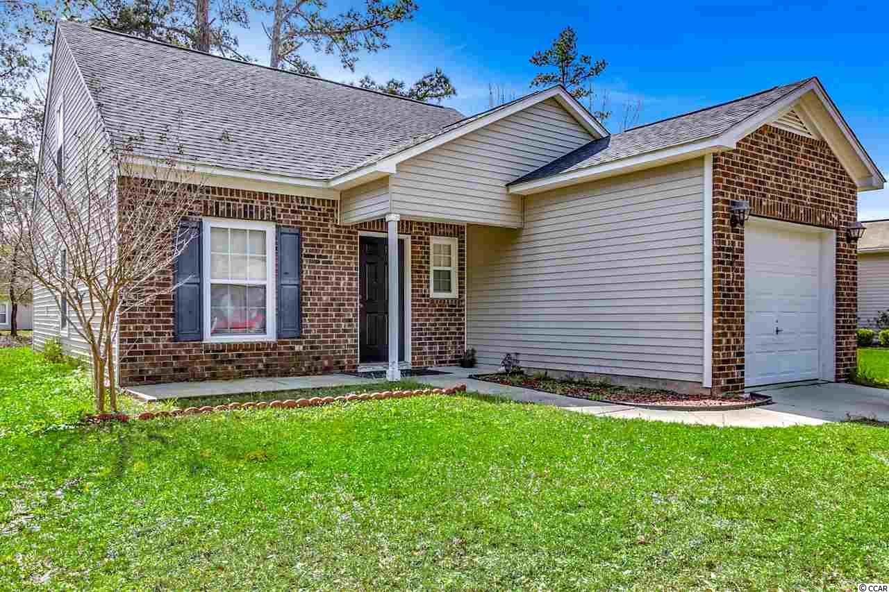 Great opportunity to be out the door and have your toes in the sand in LESS than 10 minutes! Move in ready 3 bed, 2.5 bath home with a NEW ROOF and gorgeous lake views in the serene Carolina Forest neighborhood of Belle Grove Oaks. A brick veneer elevation sets this home apart as you enter this spacious home with first floor master bedroom with walk in closet and en-suite bath. The living room / dining combo is accented by your own Carolina Room with vaulted ceiling and tons of windows letting the natural Myrtle Beach sunshine flood in. You will be overwhelmed with satisfaction as you look out onto your perfectly sized back yard with mature trees and lake view making any worries seem distant. The kitchen with tons of white cabinets contrasts the dark counter tops perfectly and is tied together with white appliances for a trendy clean feel. The half bath perfect for guests and the laundry room complete the first floor level and lead out to your attached garage. Bedrooms two and three with walk in closets are upstairs and share a full bathroom. Bellegrove has great amenities including pool / clubhouse, grilling area and playground.Being in the Carolina Forest neighborhood that is closest to the beach has its advantages as you can avoid the Blvd traffic with almost direct access to International Drive. This location is ideal making getting to the ocean a breeze as well as the easiest access to Conway, or North Myrtle Beach / Georgetown by Hwy 31 heading north or south, all while avoiding Hwy 501 and Carolina Forest Blvd completely! Square footage is approximate and not guaranteed. Buyer is responsible for verification.
