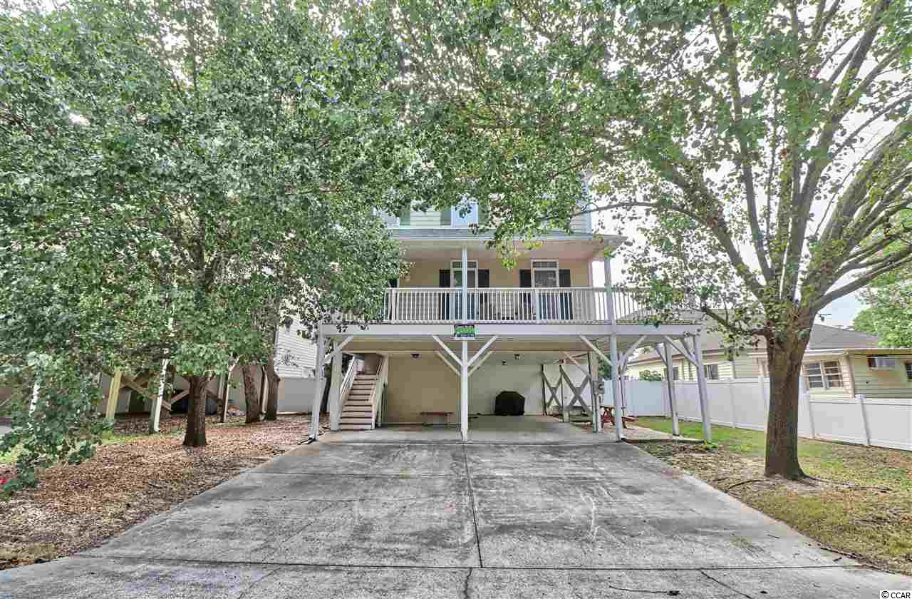 Short Term Rental with NO HOA FEES!  Conveniently located in the heart of Surfside near the park, public library, tennis courts and the Farmers Market - easy walk to the beach and great dining options.  Fully furnished 3 bed/2.5 ba raised beach house at this price is a rare find in the rental district.  Call today!