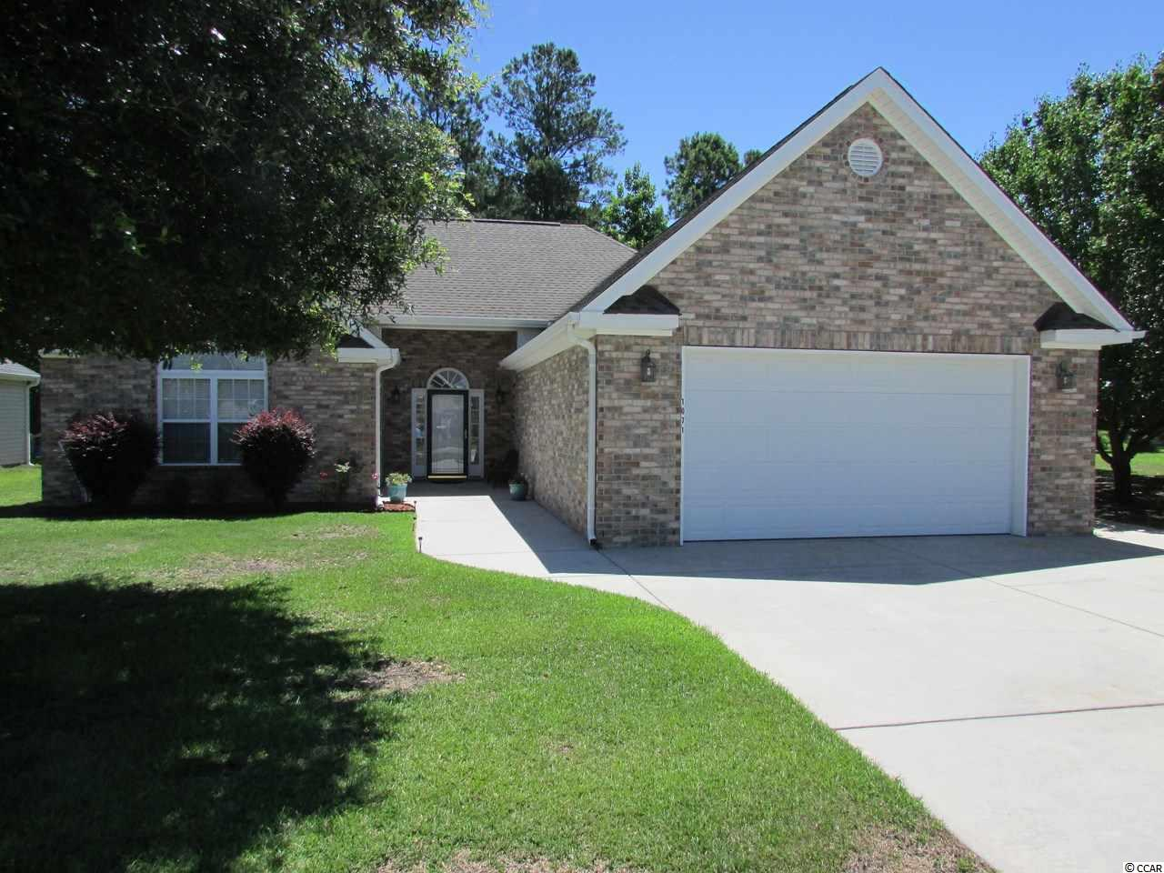 This is a MUST LOOK! As of 7-10-19 there are only 4 listed and this one is the lowest priced of the 4 and it is BEAUTIFUL. Maybe the best home you can see in the area in this price range. A regal front to what appears to be the BIGGEST lot in the neighborhood. The Lot to the right is a buffer zone leading to the lake (Not public access) so the home owners have planted Bradford Pear trees to make it their own private park. Cathedral ceilings in the living room with the Fireplace just left of the French door enclosed Carolina rm. A HUGE screen porch looking out onto the lake on the back corner of the rather large lot. Imagine coming out of your Huge Master bedroom with its Huge walk in closet, trey ceilings, master bath with dbl. bowl sink, garden tub and walk in shower (and private water closet). There is also a large garage with laundry tub, 80 gal hot water heater and large storage area above garage with drop down access latter and whole attic fan. A propane gas fireplace. An irrigation System. A Mana Block plumbing system. Also a built in Murphy bed in front bedroom Imagine sitting at your breakfast table looking out over the lake at the ducks and swans. Lake and common area maintenance is included and rv/boat storage is available. Imagine your guests out on your enormous screen porch enjoying that same view plus the self made private park in the lot next store (aka buffer zone). Imaging the other beautiful homes in your neighborhood only 20 minutes to the ocean and just about every kind of shopping and eating experience you have every dreamed of. Imagine living the good life in an area that some call the land of milk and honey.