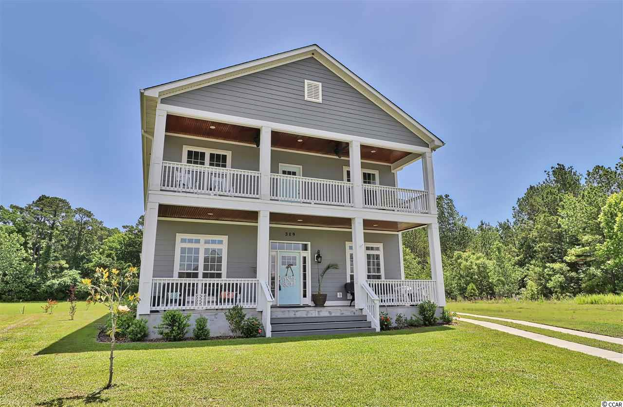 Don't miss this beautiful Charleston style house centrally located in North Myrtle Beach! Enjoy watching boats pass on the double front porches with waterway views from the second floor porch, on a quiet cult de sac! Built in 2014, this house is loaded with character and upgrades including wood floors and tile throughout, granite countertops, screened in back porch, 10 foot ceilings downstairs, double vanities in master, his and her spacious walk in closets, jetted tub, and beautiful crown molding and custom wood work. This home also has an above garage storage and below the stairs storage, perfect for keeping the home organized. It also has a walk in pantry as well as another pantry in kitchen. It has an extra living space upstairs with a wet bar and mini fridge. It conveniently has a mud room/laundry room with a sink and storage cabinets. The office downstairs has an adjoining full bath, and has custom coffered ceilings and could be converted into a bedroom if needed. This home is also a golf cart ride from the beach! Priced under appraisal as of 5/18/2018. Square footage is approximate and not guaranteed. Buyer is responsible for verification.