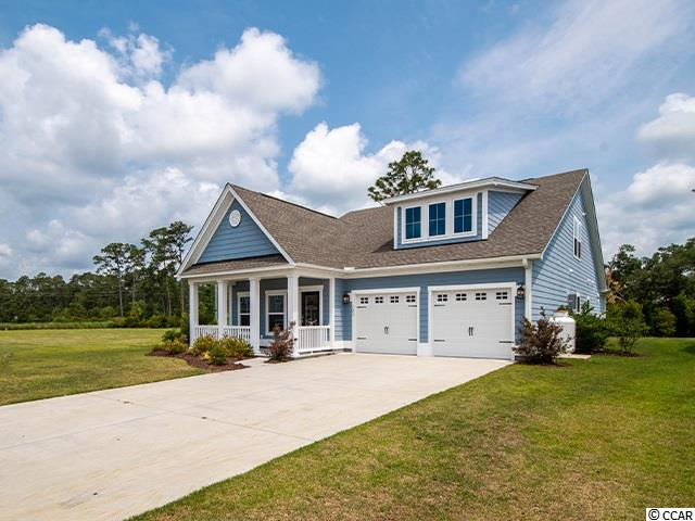 This wonderful move in ready home is spacious and like brand new. The Colony neighborhood is a quiet, friendly community on the south end of Pawleys Island. 123 Southgate has 4 bedrooms and 3 full baths. The master is found at the back of the house and on the main level with a tray ceiling, custom walk-in closet, and big master on-suite. Each room has its own ceiling fan perfect for South Carolina's warm, sunny weather. 123 Southgate also has its own vector security system that mans all the doors and windows in home. As you enter the front door, there is a formal dining room that can be used for dining or an office. The kitchen and living room are an open concept with a beautiful gas fireplace located in the living area.The kitchen is equipped with granite counter tops and stainless steel appliances. Two bedrooms are also found near the living room that share a bathroom with a double sink vanity. The 4th bedroom is large and upstairs, perfect for guest or a game room. This home also has a great screened porch which a patio attached and is adjacent to The Colony's Common area, perfect for outside activities! This home is only 3 years old and very well maintained and could be a perfect place to call home.