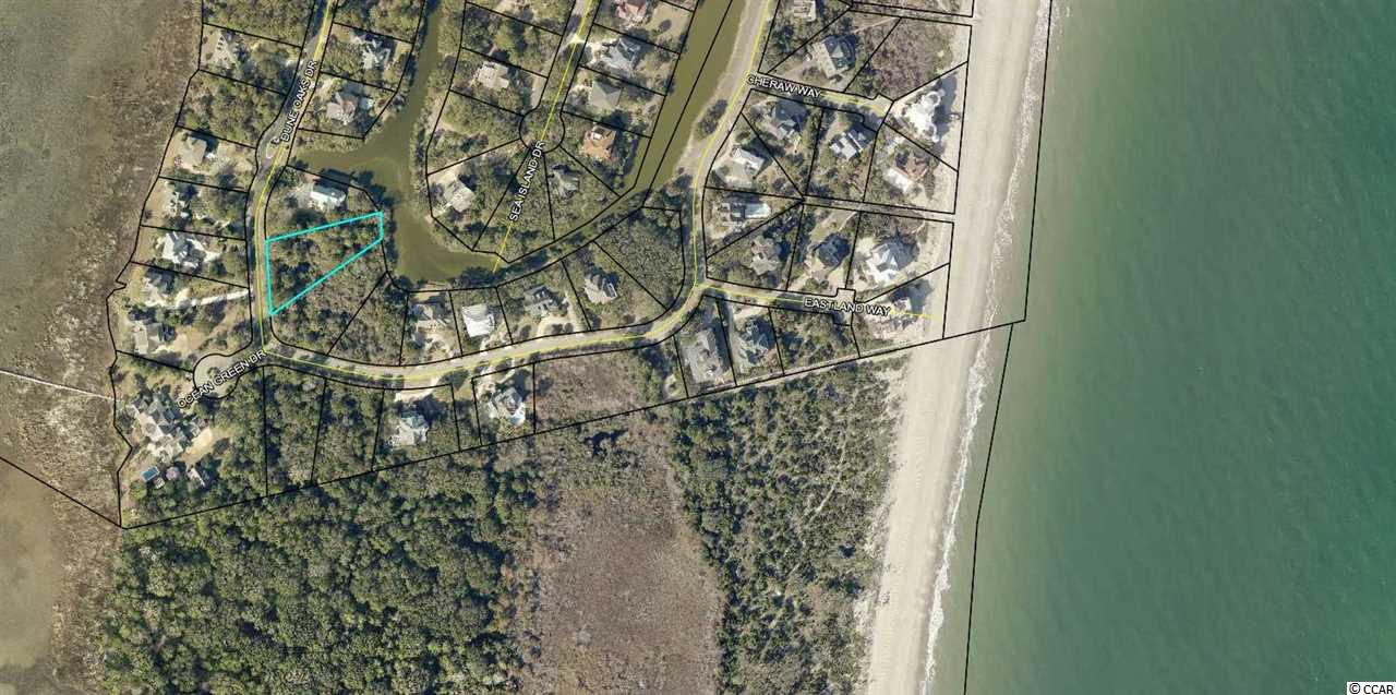 Lake and potential Marsh Views with close proximity to the Beach and the privacy of Hobcaw Barony, Lot 8 in Ocean Green II is a prime location for your beach home within the gates of DeBordieu Colony.  Over 1/2 an acre in size, this homesite opportunity provides plenty of space for your primary or secondary residence to enjoy for years to come.  Property owners and club members enjoy a private golf course, tennis club, oceanfront beachfront club with fine and casual dining, a beautiful beach, and a community boat ramp with convenient access to the pristine North Inlet estuary. DeBordieu Colony is located between Pawleys Island and Georgetown, South Carolina.