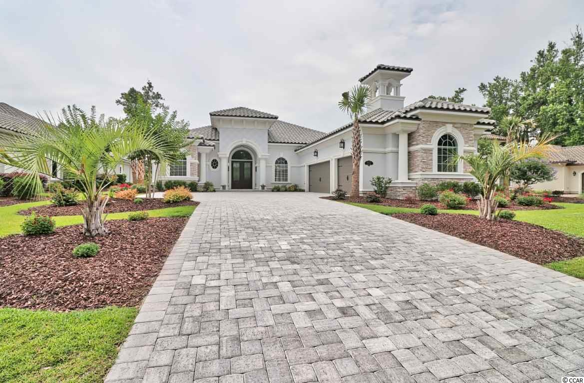 This home is nearly brand new and is located in Grande Dunes, a prestigious gated community in Myrtle Beach.  Completed in 2018, this meticulous home is light, airy and has an open floor plan, making it a great home for entertaining.  It boasts 3 bedrooms, each having it's own full bath with granite counter tops.  It also has a large bonus room overlooking the pond, that can easily be a fourth bedroom, den office or media room.  The kitchen is a cook's delight, with Kitchen Aid appliances, a gas stove top, built in convection oven and microwave with striking granite counter tops.  The walk -in pantry is conveniently located and provides plenty of kitchen storage.  This home has an eat in kitchen along with separate formal dining area.  The family room has a gas fireplace with built in cabinets and shelves on each side.  The home is a real stand out with porcelain tile floors throughout all living areas, while the bedrooms are carpeted.  No detail was spared with the ornate trim work and tray ceilings in the dining room, bonus room, and master bath.  The double tray ceilings in the foyer, family room and master bedroom add to the exquisite ambiance of this home. Large master bedroom with spacious sitting area overlooking the pond.  Separate master closets are outfitted nicely with full built-ins.  The master bath is roomy and well appointed.  The laundry room has two closets and plenty of cabinets for storage along with a granite counter top sink.  The full three car garage is equipped with a mini split system that provides A/C or heat, making the garage a comfortable place to be any time of year!  The family room has stacked sliders that open up to the lanai.  The spacious back yard has plenty of room for a pool and is a peaceful retreat.  Relax while sitting on the covered lanai overlooking the pond, all on a .37 acre lot.  You must see this home to truly appreciate all that it has to offer!