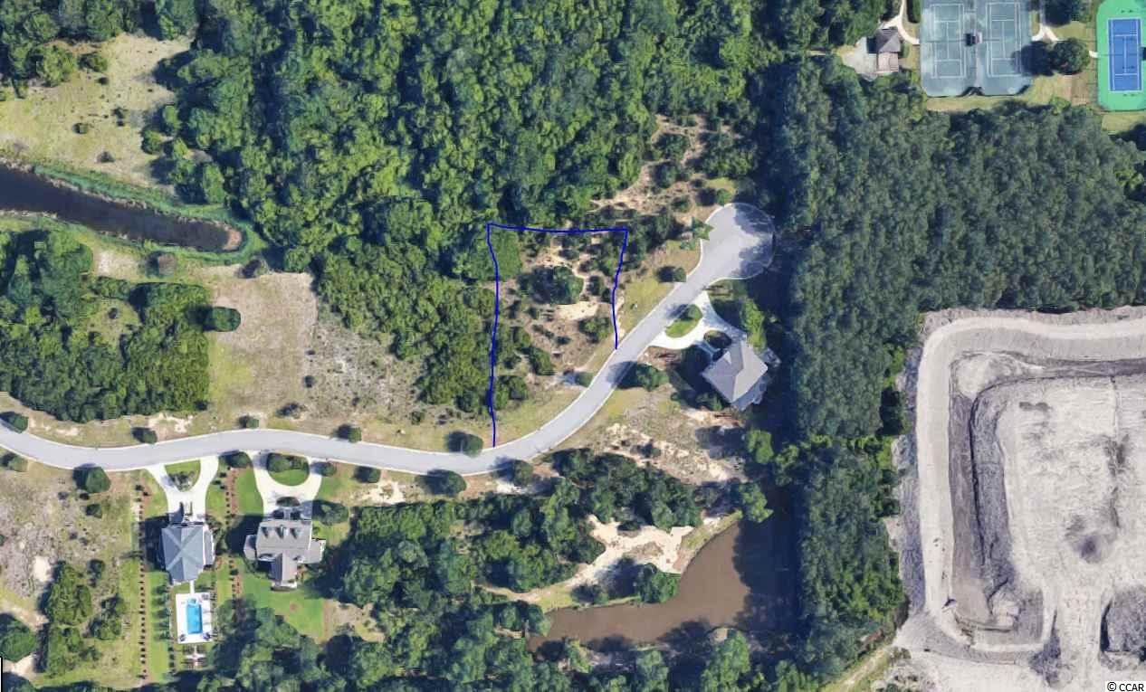Fantastic opportunity to secure the perfect home-site in the exclusive DeBordieu Colony of Pawleys Island, one of South Carolina's premier beach and golf communities! Build your dream home on this beautiful wooded lot! This incredible home-site offers beautiful scenery, surrounded by lush, mature trees and scenic views in this gated, beachfront community! The community boats the private Pete Dye golf course!  Golf cart or walk to the gorgeous beaches or use the community boat landing and spend the day with your friends or family in North Inlet. Owners can join the exclusive Owners Club, granting access to golf, tennis, onsite restaurants, a private beach club with pools, tiki bar on the beach and so much more! Live the luxury that is DeBordieu!