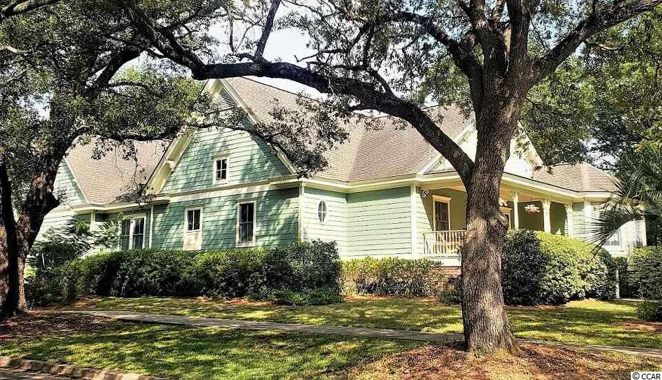 Built just 15 yrs ago, this Lowcountry BEAUTY is surrounded by the old Historic Georgetown Homes circa 17-1800's! *Beautiful CORNER LOT here with private rear yard. Majestic oak trees line the sidewalks and give shade where needed. You will love walking downtown to be entertained or to shop and dine on the waterfront! This southern charm lies quietly on a well appointed larger lot,  'just 2 blocks to the Harborwalk. IF you fish or boat, you will enjoy Winyah Bay, where many rivers come together for fresh and saltwater catches! A true front porch for rockin' and mature landscaping provides complete privacy in the backyard and side. Numerous oaks, bountiful shrubbery and blooming azaleas live on the property. Just mulched * Inside you will find the wide open concept most seek and this Home is completely Handicap accessible so this could be your forever Home! Warm cherry flooring, crown molding is literally throughout, high baseboarding, chair rail, flat ceilings with recessed lighting and Charleston color scheme makes this place so inviting and cozy. Large Carolina Rm overlooks the backyard beauty and the birds come and go all day. The Owners suite is spacious and the light pours in - sep. walk in closets and a bathroom that will blow your mind in design :) Bedroom 2 is also on the mail level near the half bath, office area, laundry room and exit to garage or entrance upstairs to Bedroom #3. No space was wasted as you will see (especially upstairs where various closets and large storage areas were added). I love this room because it's so sunny and looks down over the gorgeous backyard and its has big closets and a great bath layout. If you have wanted to be in the Historic section of Georgetown, but were not needing (nor wanting) a Home built centuries ago, then THIS Home is for YOU ~ we'd LOVE to see your offer!
