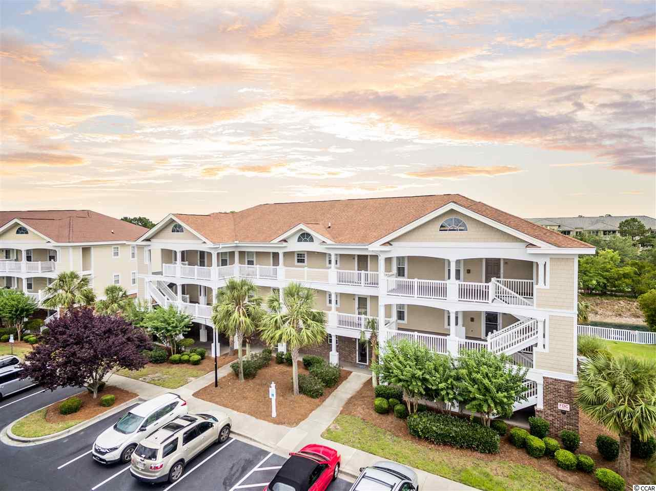 FIRST FLOOR UNIT means NO STAIRS to climb! Walk your luggage & your groceries right up the sidewalk and in the Front Door. This beautiful ground level condo is located in the IRONWOOD complex inside BAREFOOT RESORT. Located just a short walk to the Ironwood pool, tennis court, volleyball court, & basketball court, this Condo is very clean. It features 2 Bedrooms, 2 Bathrooms, a spacious kitchen, Master Bedroom with 2 closets, & a private screened porch with a storage closet. An exterior exit on the screened porch allows for easy access to the back yard for walking your dog or feeding the turtles in the fenced pond behind the building. HOA fees include Wireless Internet, Cable TV, Phone Service, insurance, common maintenance/repair, lawn/landscaping, water, sewer, trash, pest control, and access to the Barefoot Beach Cabana, offering gated parking, private access, & a seasonal shuttle service from Memorial Day to the end of October. All owners also have access to a 15,000 square foot salt water pool directly on the ICW. BAREFOOT LANDING is located just across the swing bridge & is home to the House of Blues, Alabama Theatre, LuLu's Restaurant, Blueberry's Grill, Flying Fish Public Market & Grill, Wild Wing Cafe, & plenty more. More shopping is located nearby at Tanger Outlets, Walmart, & the Myrtle Beach Mall. Call & schedule a showing today, this first floor unit shouldn't last long.