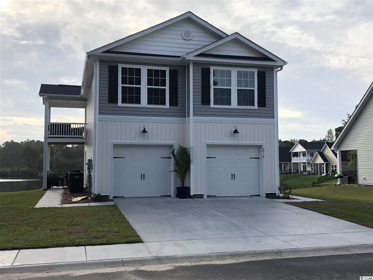 There are only 3 new homes remaining, don't miss out! This community has back or side porch views that over look a beautiful 28 acre lake. The home comes with white cabinets, double vanity in master bath, granite counter tops, upgraded luxury vinyl plank flooring, and vaulted ceilings. Low HOAs and conveniently located with easy access to Murrells Inlet, Garden City or Surfside Beach, Hwy. 17 business or bypass and 707. Pictures and virtual tour are representations from a similar home. Features and selections may vary.