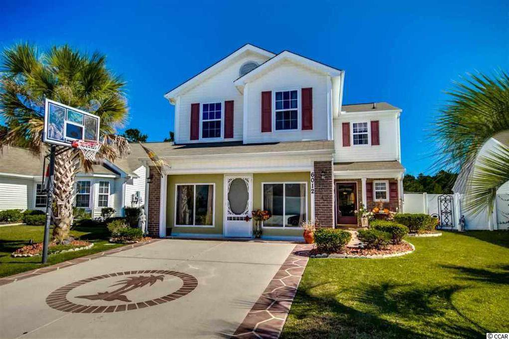 """This incredible waterfront home is a family dream home!!This spacious 4 bedroom, 2 1/2 bath property, is a hidden gem perfectly located in the ever popular development of the Avalon in Myrtle Beach's most wanted move in location of Carolina Forest! Tucked away, this amazing home has the most incredible water views of a natural lake surrounded by the Lewis Ocean Bay nature preserve that will NEVER be built on! With excellent privacy, experience the breathtaking view of the sunrise from the comforts of your Master Suite or sneak outside and sip your cup of coffee rocking under the gorgeous wooden farmhouse, inspired lanai! This home has been cherished dearly by the same family since built and upgraded with finer touches as the years have gone by. From crown molding to tiled hardwood flooring downstairs, this home is a must see in person. The cozy kitchen has been redone with appliances that are top of the line stainless steal by Samsung, surrounded by upgraded cherry wood cabinets and dark countertops. The backsplash throughout, matches and enhances the look for just the perfect final touch. The uniqueness of this home also includes the transformation of the 2 car garage that has been redone and is now used as an additional Bonus Room/Playroom (with tons of extra storage). This renovation added insulated walls, large windows and another point of entry front door, to come in from the driveway. The garage door seamlessly opens up normally and tucks into the ceiling for aesthetic purposes within the neighborhood. This awesome upgrade is optional and easy to convert back to """"normal functioning garage"""" if needed. The property also has the convenience of a large outdoor shed that can hold all tools and outdoor equipment. Upstairs, you can find a convenient laundry room and four spacious bedrooms including a gorgeous master bedroom with a walk-in closet, a master en suit and of course the unforgettable wooded lakefront views!!! Come see for yourself all the amazing potential"""