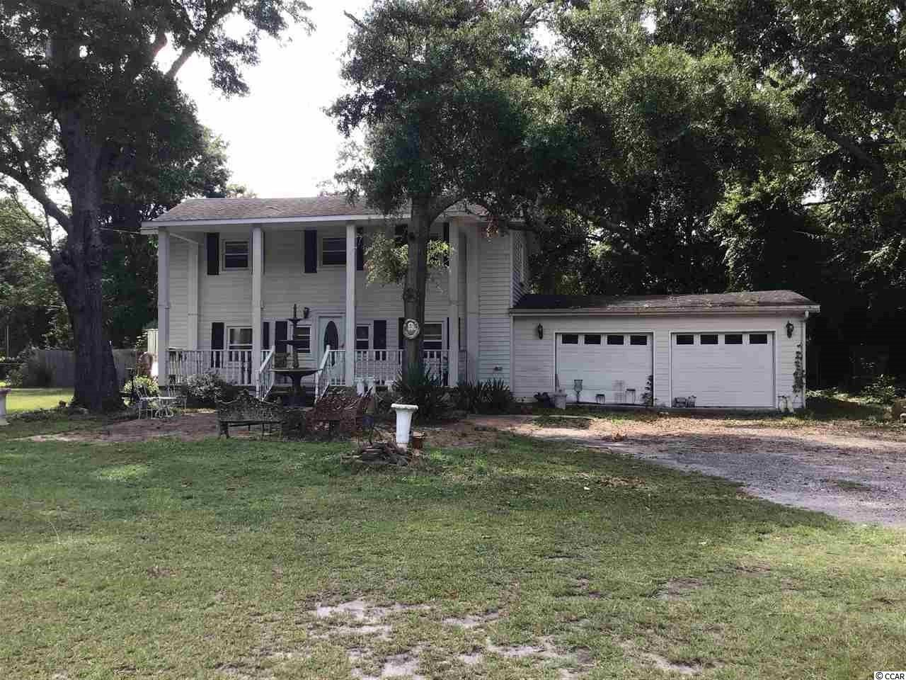 This home is located in the heart of Murrells Inlet not far from the  Marshwalk and all of the seafood restaurants you could ever want. Have you been looking for a home with a big yard that's not in a cookie cutter neighborhood ? Here it is ! No HOA, so you can part your boat, etc without an issues. This home has a 2 car garage and  sits on .77 acres.