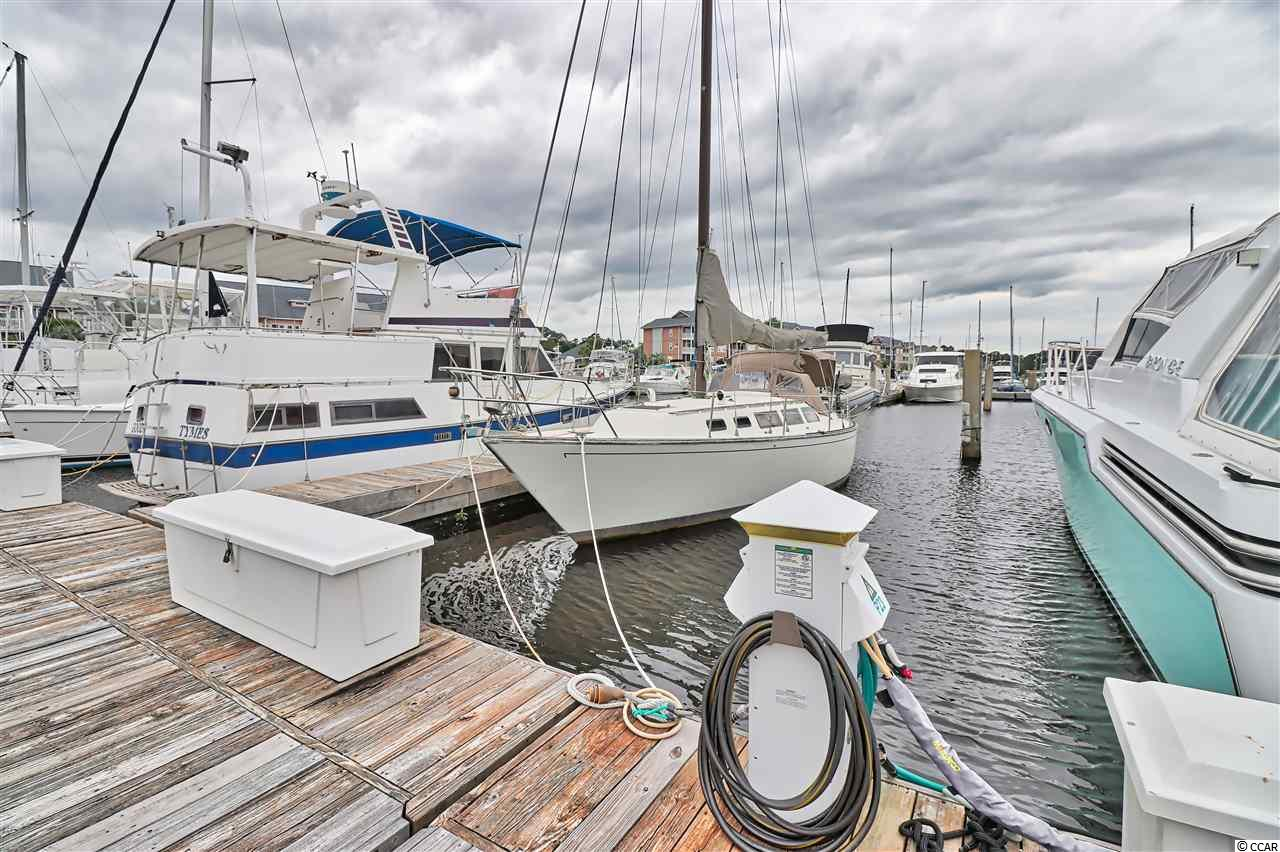 This 46 ft. membership boat slip is located in prestigious Lightkeepes Marina. Ship's store with bath and laundry facilities, pool, water, insurance, taxes, maintenance on the docks, future dredging fund all included in monthly fees. Fuel, pumpout in marina. No bridges to ocean.