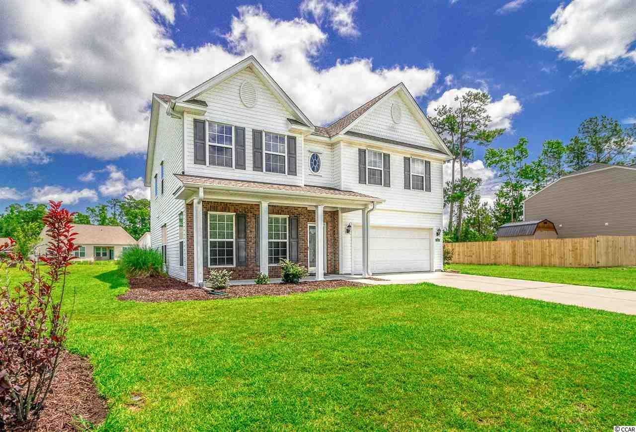 LOCATION,SIZE,AND PEACE AND QUIET.  This immaculately maintained 5 bedroom 2 1/2 bath home hits all the big boxes on your new home checklist.  Location is always key and this beauty puts you only 10 minutes to the beach,  2 miles to Hwy 31, and centrally located to all the shopping,dining, and entertainment the Grand Strand has to offer.  This home gives you the space to stretch your legs with over 3100 square feet of living space with a functional floor plan that makes the best use of all the the new room you have to call home.  Upgraded cabinets, bamboo flooring, lighting, stainless steel appliances, and fixtures throughout give this gem the WOW factor without breaking the bank.  Enjoy your morning coffee on the covered patio out back overlooking the pond before you pack everybody up and head to the community pool right around the corner.  Seeing is believing on this property so book your showing today because it wont last long!  WELCOME HOME