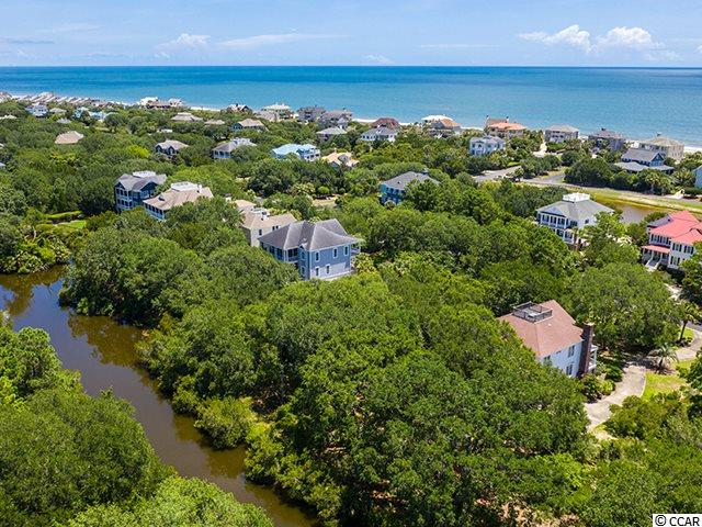 DeBordieu Colony - Sea Island -  Lot 16 is a spectacular lake front near beach homesite on a quiet culdesac on the Island of DeBordieu Colony.  This homesite is approximately 250 yards from the waters of the Atlantic Ocean - the perfect proximity for a home setting. Lot 16 Sea Island Dr. is a short cart ride to the Beach Club, dining, pools, playgrounds, crabbing & fishing - making it ideal for the purchaser who takes pride in constructing a large, lovely beach home. DeBordieu Colony offers access to 6 miles of secluded beach, 24-hour security gate, surrounding environment protections, private Fitness center, private golf & tennis, community boat ramp, saltwater creek access, boating, nature preserve with walking trails & bike paths, private indoor and outdoor dining options.