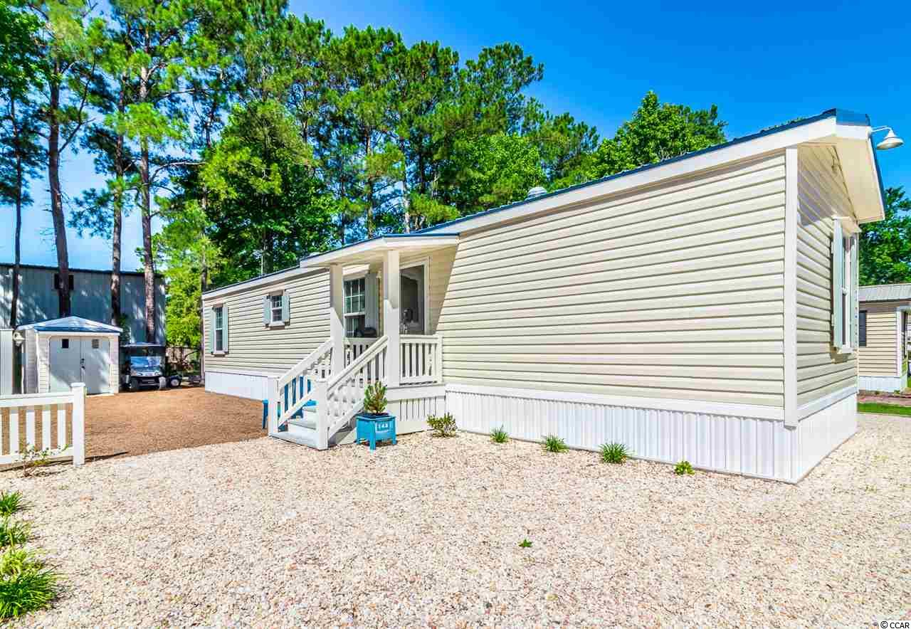 Located in the heart of Garden City.  Short bike ride to the beach, fishing pier, shopping & restaurants.  Minutes from The Murrells Inlet Marshwalk, marinas & golfing. Perfect for the beach get-away, retirement or primary residence.  This unique & immaculate 2bd/2ba beach cottage, built in 2015, sits on a nice lot with plenty of room to play. Custom built features include hurricane shutters, metal roof , private courtyard and upgrades thru out the home. Storage shed with electricity.  The Community offers a swimming pool/clubhouse, boat/RV parking & A Lake.  Pets, motorcycles & golf carts are welcome.  Buyer must complete a lease agreement with Windjammer Village as a condition of the sale.  No rentals are allowed in this community.   Financing is available.  Square footage is approximate and not guaranteed, buyer is responsible for verification.