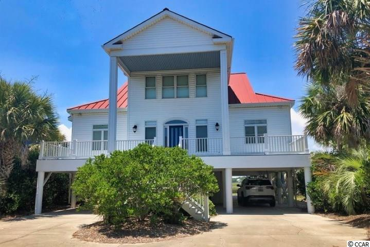 Located not far from the marina, on one of the widest portions of the beach, this deep water creek home is set up for a boat lover's vacation destination. With a fixed and floating dock, you are ready to enjoy all of your water adventures. Directly across the street is the beach, close at hand for more fun water options. This four bedroom, three and a half bath house features open aired porches, a generous screened porch and views of the beach and Murrells Inlet creek. There is ample room to entertain friends and all of the creature comforts needed for a fantastic stay at the beach. There are opportunities to spiffy up this home to make it an absolute show stopper. Be sure to check out the walking video tour of this great property on my YouTube channel.