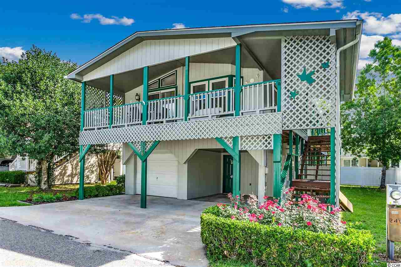Absolutely immaculate raised beach home in the much desired Oceanside Village. Golf cart ride to a gated beach parking lot next door to the oceanfront Conch Cafe! Large porches, HUGE workshop and garage under home, Jenn-Air oven and Microwave, updated bathrooms, much of the furniture included. Oceanside Village has two outdoor pools, a Splash Pad for the kids, hot tub, indoor pool, library, fitness center, ponds, dog park, lots of nature and green areas. The Amenities Center is the heart of the village, with a commercial kitchen, stage, dance floor for dinners, dances, and game nights. Also, you can enjoy tennis, baseball, bocce ball, soccer, a playground, and more. Enjoy the lifestyle of living in an oceanside neighborhood.