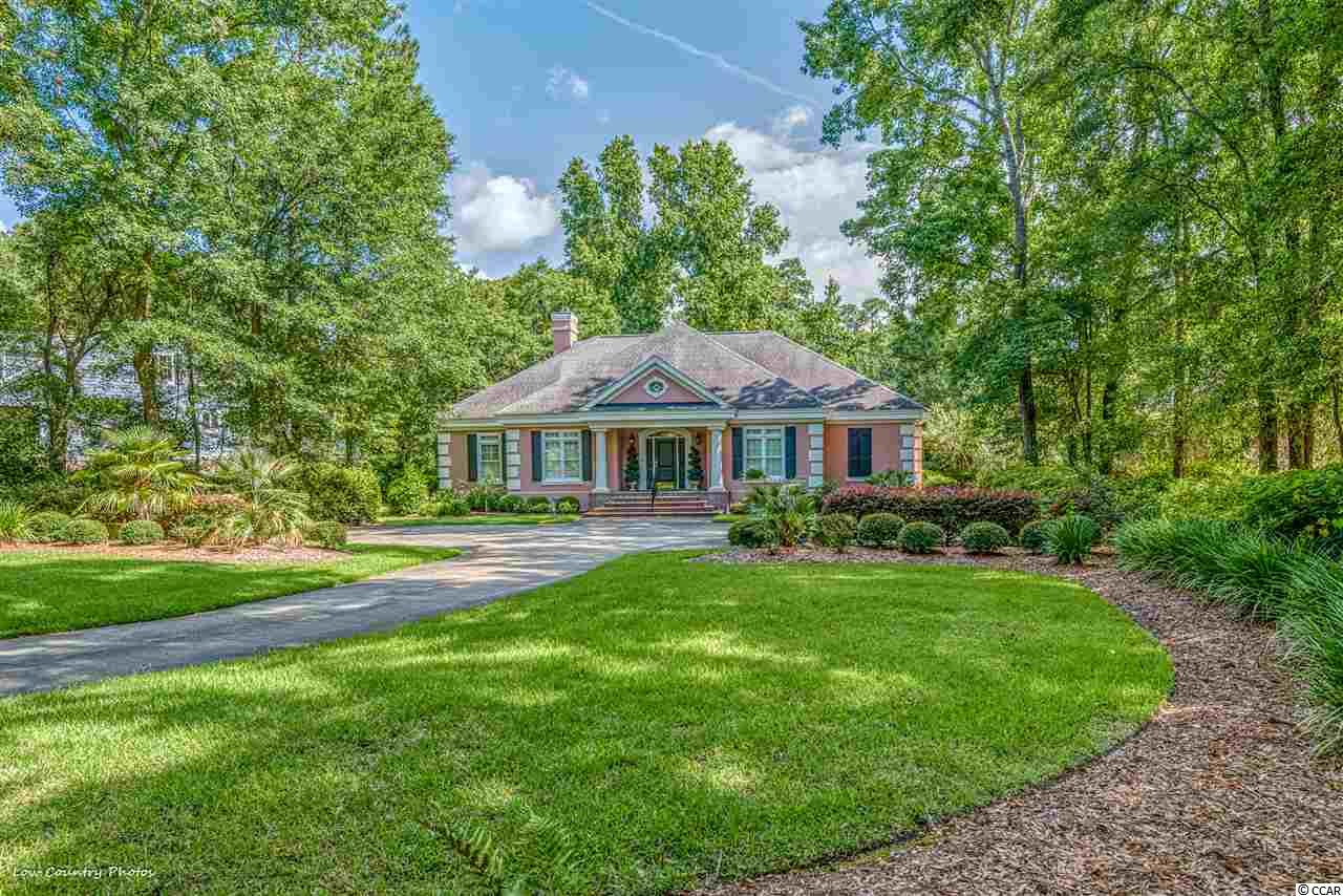 Spectacular home with 3 BR, 3.5 baths and over 3000 sq ft. of living space all on one floor! Imagine a large Master Bedroom with two full baths and two closets! This original owner home has been well maintained and is situated on a gorgeous wooded lot in the much sought after Richmond Hill section of historic Wachesaw Plantation. Features include a split bedroom plan, kitchen with island, fireplace, deck, and large glass front Carolina room on rear so that you can enjoy the views of the fabulous well- landscaped back yard overlooking the 10th tee box of the awesome golf course. This home was designed for comfort and beauty and was meticulously thought out  with extras galore. Come home to Historic Wachesaw Plantation-- one of the best kept secrets on the East Coast-- and enjoy the private restaurant, tennis courts, pool and private Fazio designed golf course with phenomenal driving range, putting green and practice traps. Once you visit you will not ever want to leave. Enjoy the spectacular surroundings with ancient, moss hung live oak trees, beautiful golf course, and of course the Waccamaw River/ Atlantic Intracoastal Waterway. Ideally located in Murrells Inlet, close to hospital, medical specialty offices, dining, the Marshwalk, beaches, and Brookgreen Gardens. Don't miss seeing this one!
