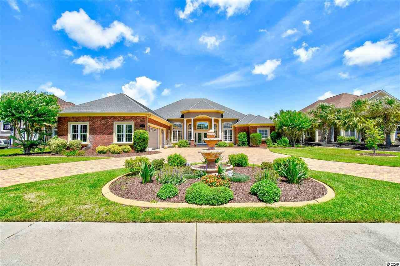 """Located in the upscale custom luxury home community of Plantation lakes is a jaw dropping all brick, single level, executive style home with more than 5200 heated square feet of living space. This home showcases countless features and sits on a premium water lot with 100' of lake frontage. Starting from the outside of the home you will see the half moon driveway constructed with beautiful paver stones and an over code 12"""" base giving access to the extra deep 3 car garage. Stepping into the foyer you'll appreciate the absolutely spacious split bedroom open floor plan featuring large tile flooring, 18ft multi-layered back lit tray ceilings, built in surround sound and sound proof walls all this while having lake views from the great room and kitchen. The kitchen boasts 42"""" custom cherry cabinets, adorned with a gorgeous tile backsplash, stainless steel appliances, granite countertops and a large breakfast bar/island. The master suite features a separate sitting room and an spacious shelved walk in closet. The master bath showcases tile & glass block shower, Jacuzzi tub, linen closet, dual vanities & walk-in closets. This description is only a small fraction of what this magnificent home truly has to offer so book your showing today and come see for yourself."""