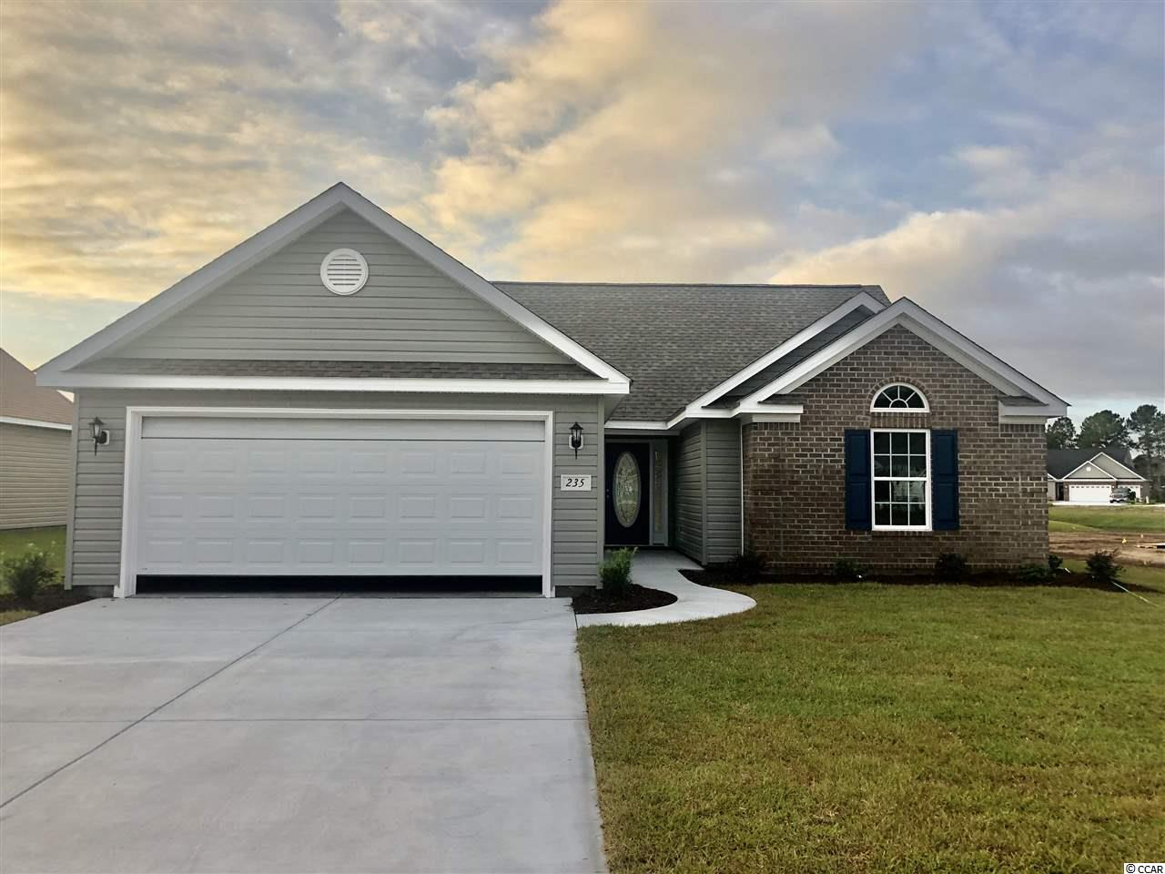Beautiful new home   The Holly Model modified  is a 3 bedroom 2 bath home w a 2 car garage with Hardwood floors, tile, granite,brick accent, large patio, stainless steel appliances