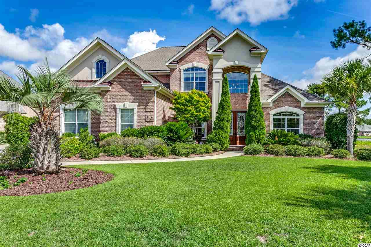 """Stunning lake views from this custom, all brick home in Plantation Lakes, one of Myrtle Beach's most highly desired family neighborhoods, located in the award winning Carolina Forest school district.  Over 4700 heated sqr ft which includes a """"TRUE MOTHER IN-LAW SUITE"""" complete with a large bedroom, master bath ( jacuzzi tub and shower), living room, kitchenette and sliding doors to the patio to enjoy the beautiful lake views.  This suite could serve many purposes, perfect for guest to have their privacy separate from the family home or would make a great 2nd master bedroom on the main level for high school or college age kids. This home offers large eat in kitchen, gas cook top, double oven, beautiful custom cabinets and granite counter tops.  The gorgeous master bedroom is also located on the main level and is oversized with fantastic views of the lake. The two story family room has beautiful picture windows from floor to ceiling even offering the best views of the lake from the upstairs cat walk.  On the 2nd floor you will find 3 large bedrooms one with it own full bath and the other 2 share a bath along with a huge bonus room that has a separate office space.  This area would be perfect for a media room or kids play room.  Also on the 2nd floor is a huge walk in attic space perfect for storing all your holiday decor or could be finished as an additional bedroom or play room.  This home could not be rebuilt at this price!  Don't delay in scheduling your appointment to view as it will not last long!"""